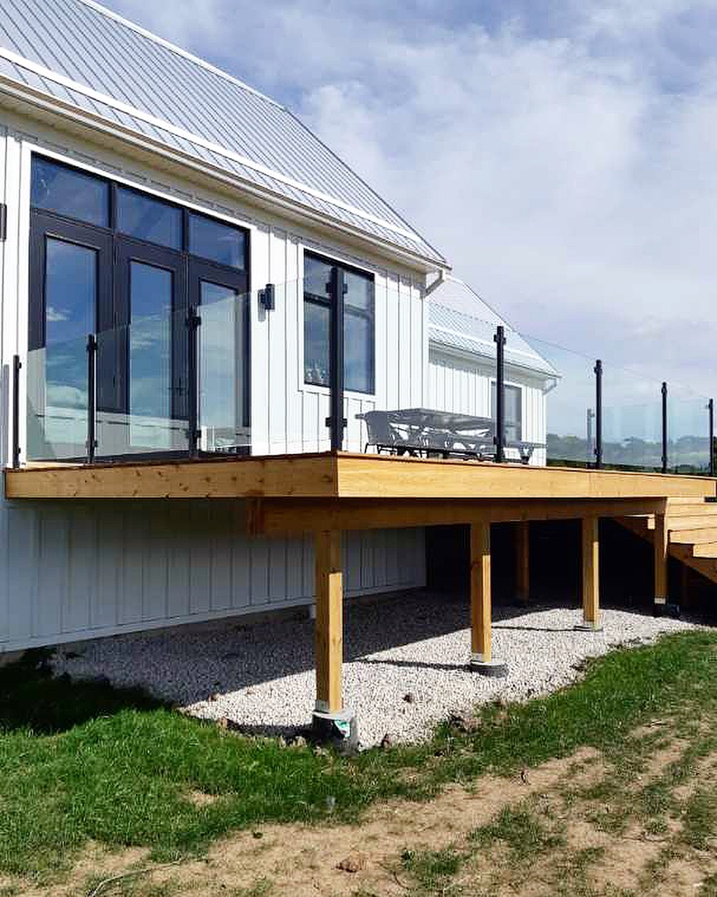 Custom fabricated/painted steel posts with 12mm clear tempered glass.  Job location: Blue Mountain, ON.
