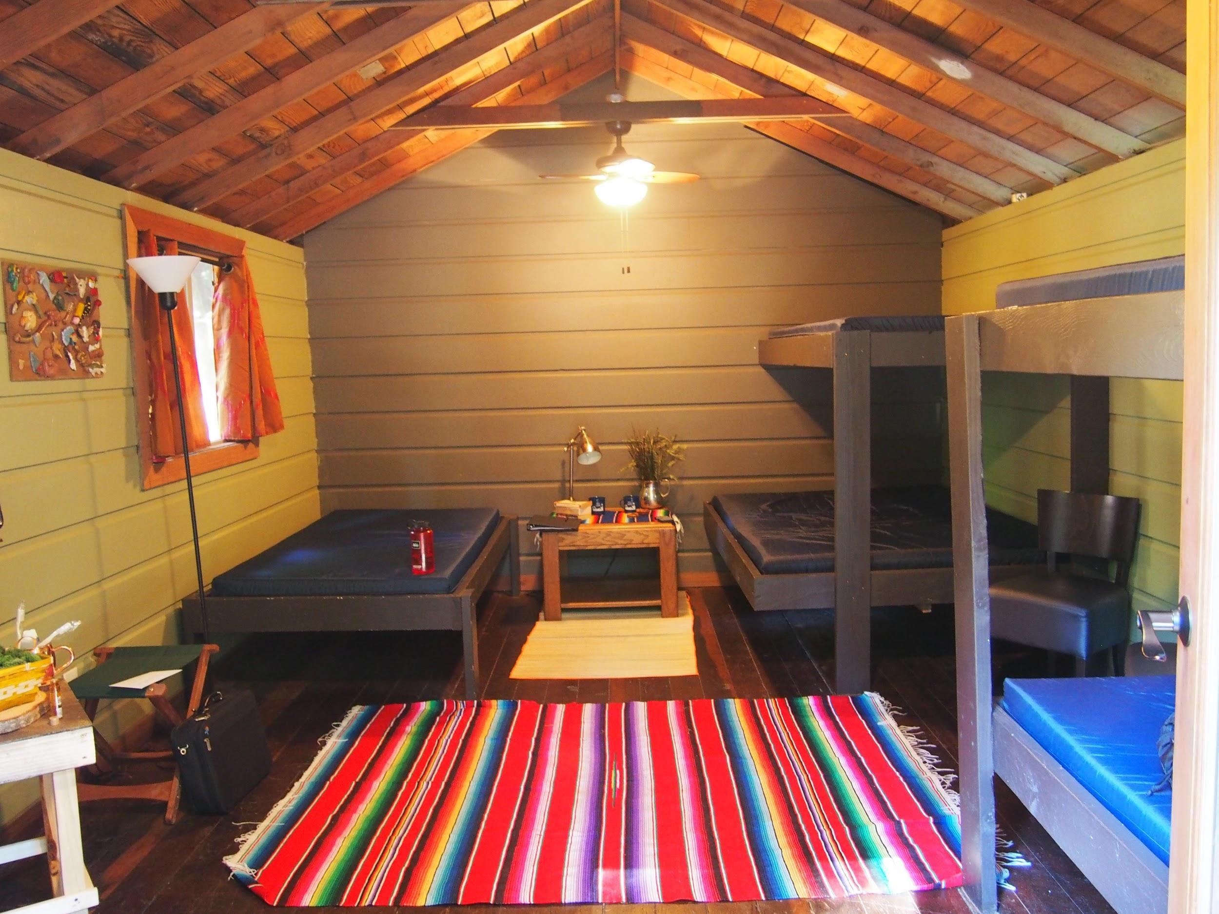 14 SHARED CABINS with electricity    Four-Walled Cabins will be prioritized for families with very small children.     * Bedding is not provided, please bring sheets, blankets, and/or sleeping bags and pillows.     **Cabins and Adirondacks beds all have foam mattresses