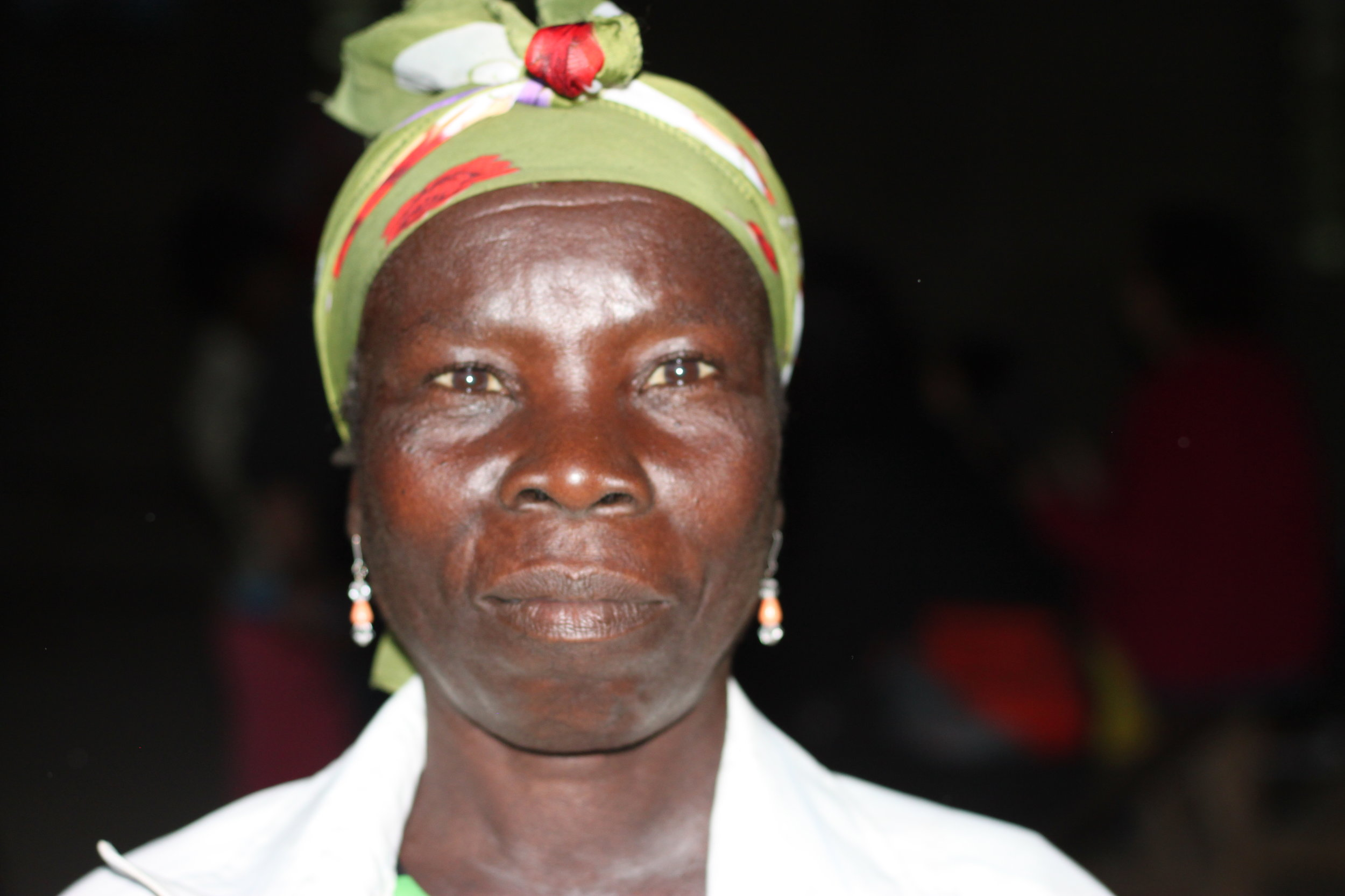 """Edwa Olain - 40 years old""""My husband has passed away so the entire family's responsibility is on me. But sometimes I cannot do the things that are supposed to be done by a man. I want to build a bigger house but I don't know how. When the church gave out cement and tin roofs, I didn't get any."""""""