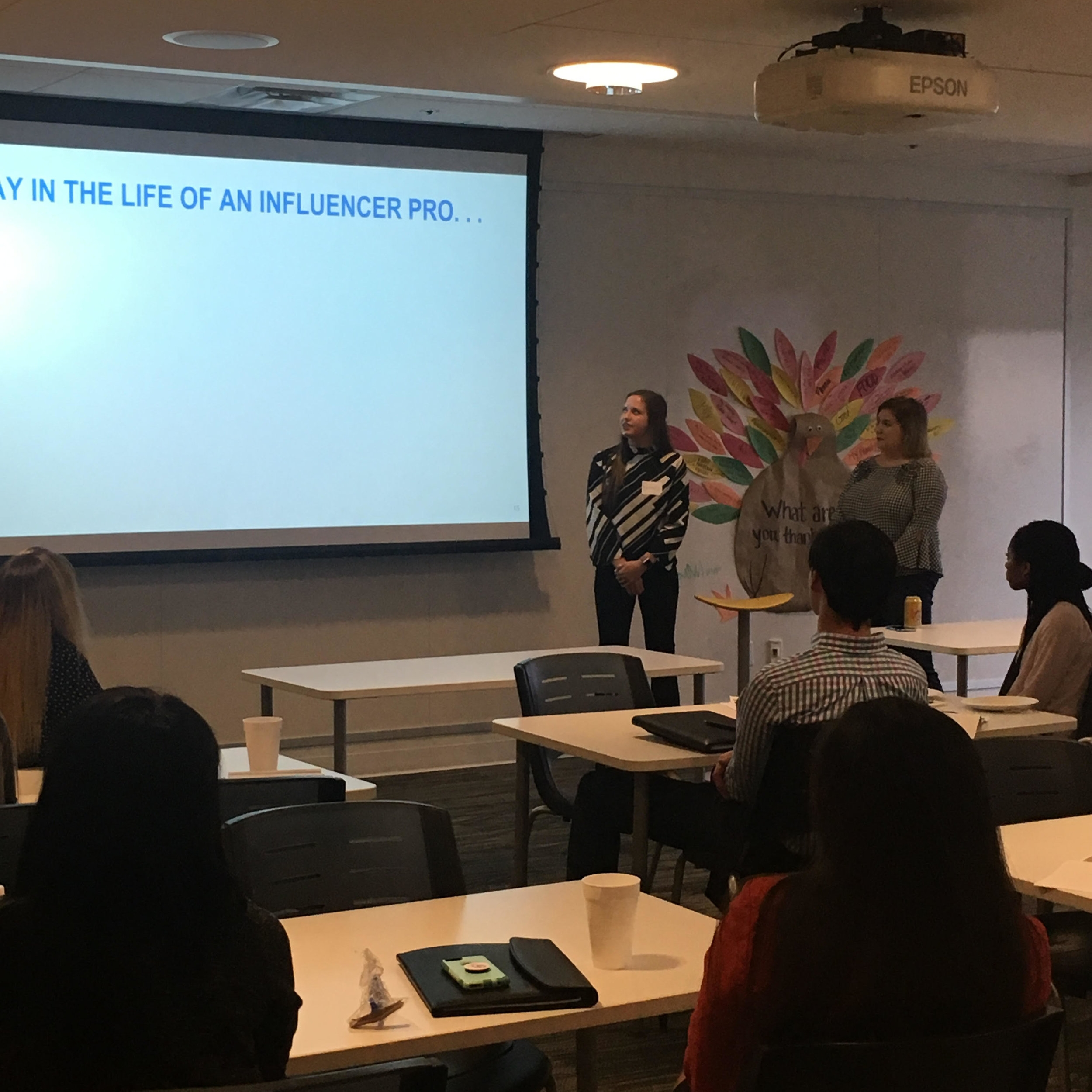 OU PRSSA Spring President Demery Pennington presents at Fleishman Hillard in collaboration with one of the agency's employees.