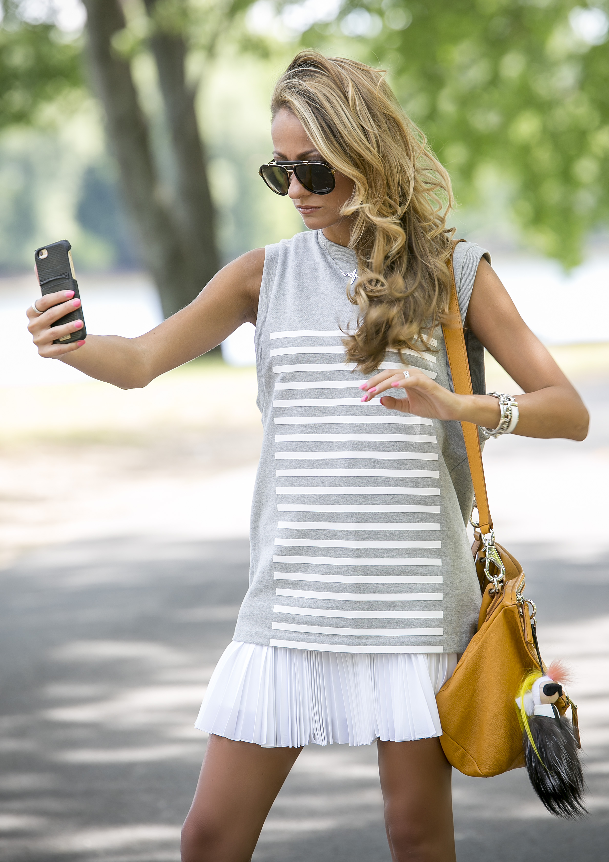 North of Manhattan showing summer style in Alexander Wang top, and skirt taking a selfie