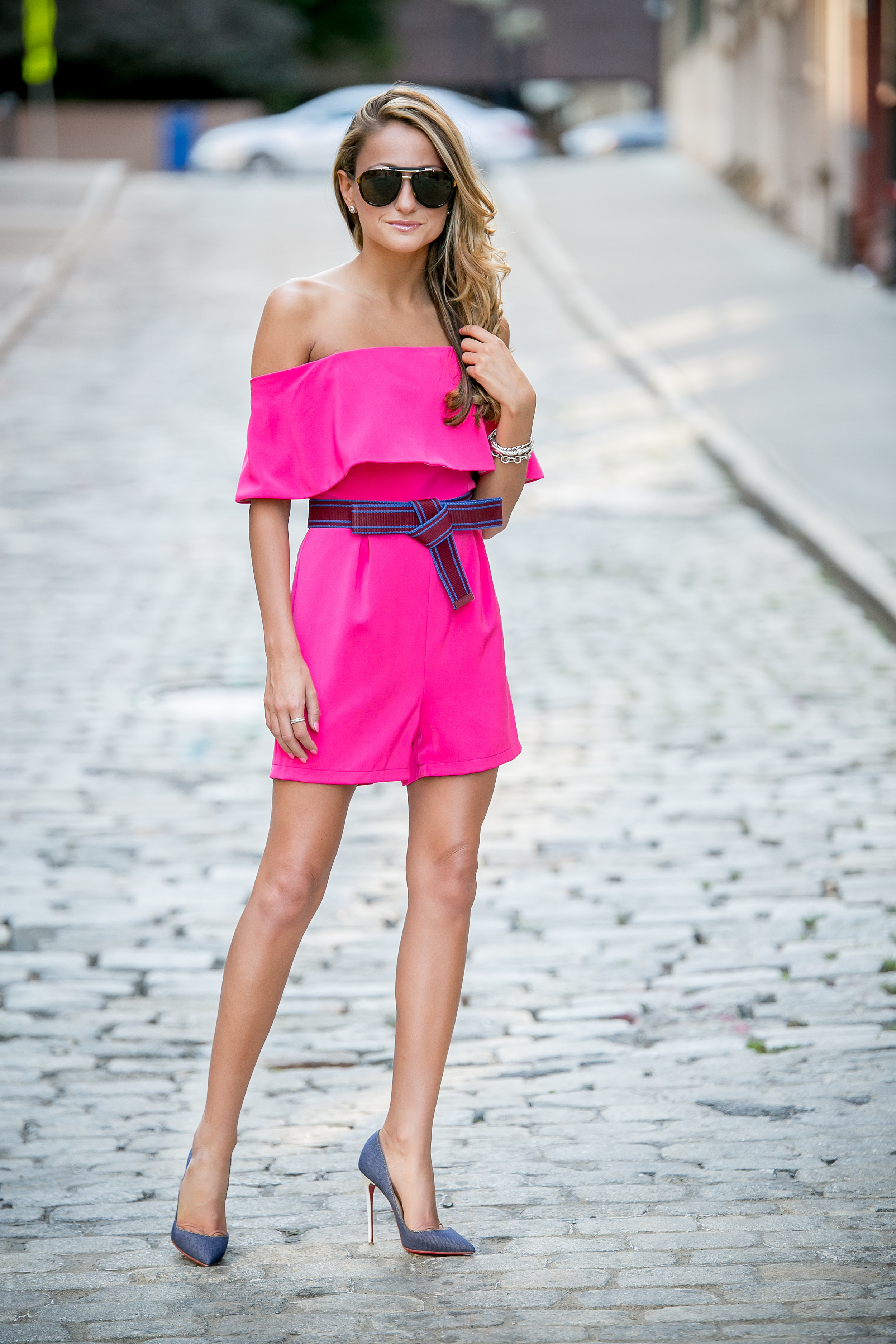 Style blogger North of Manhattan in a pink romper and denim christian louboutin pumps