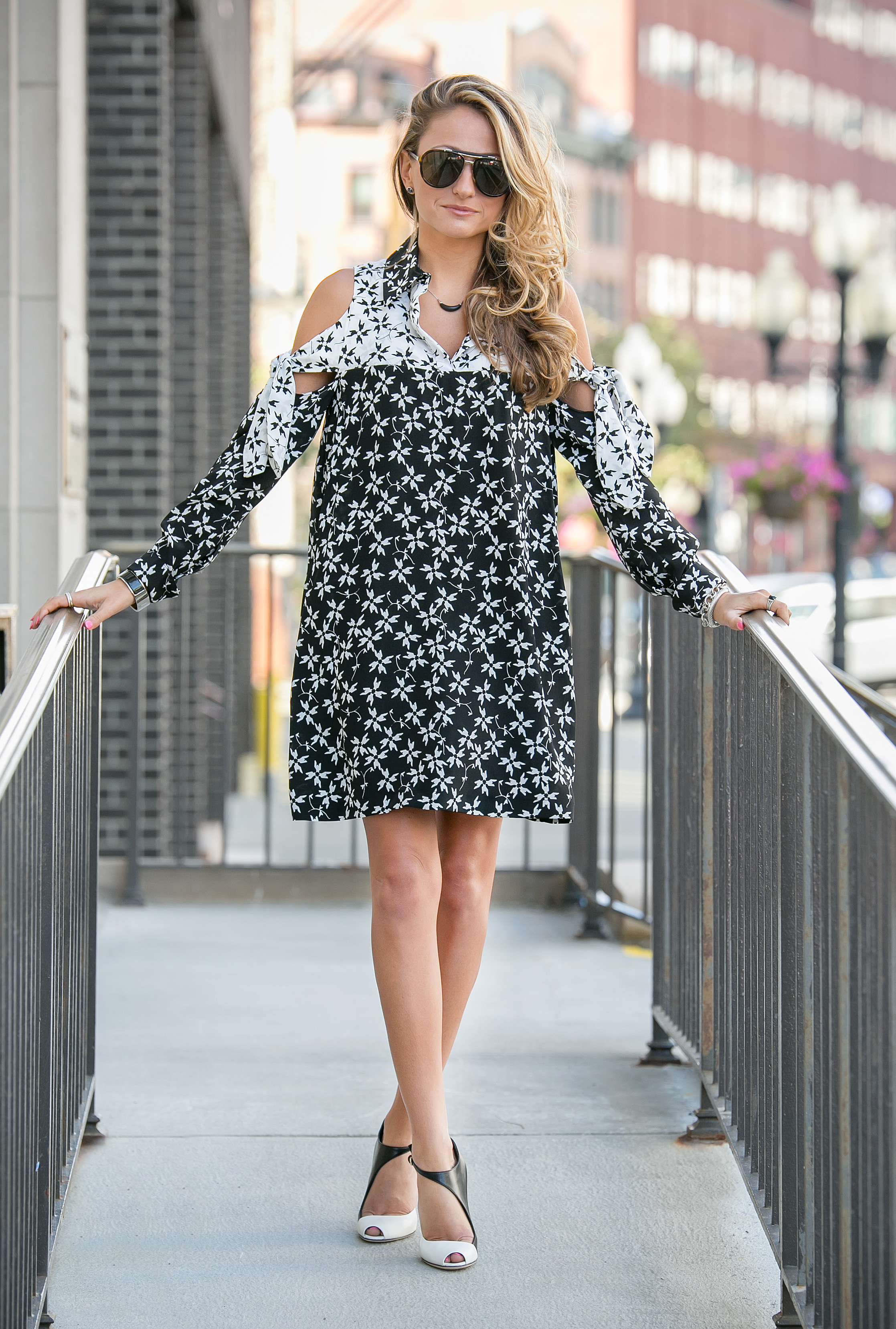 Fashionista Lauren Recchia of North of Manhattan wearing a Tanya Taylor print dress with black and white Sergio Rossi pumps