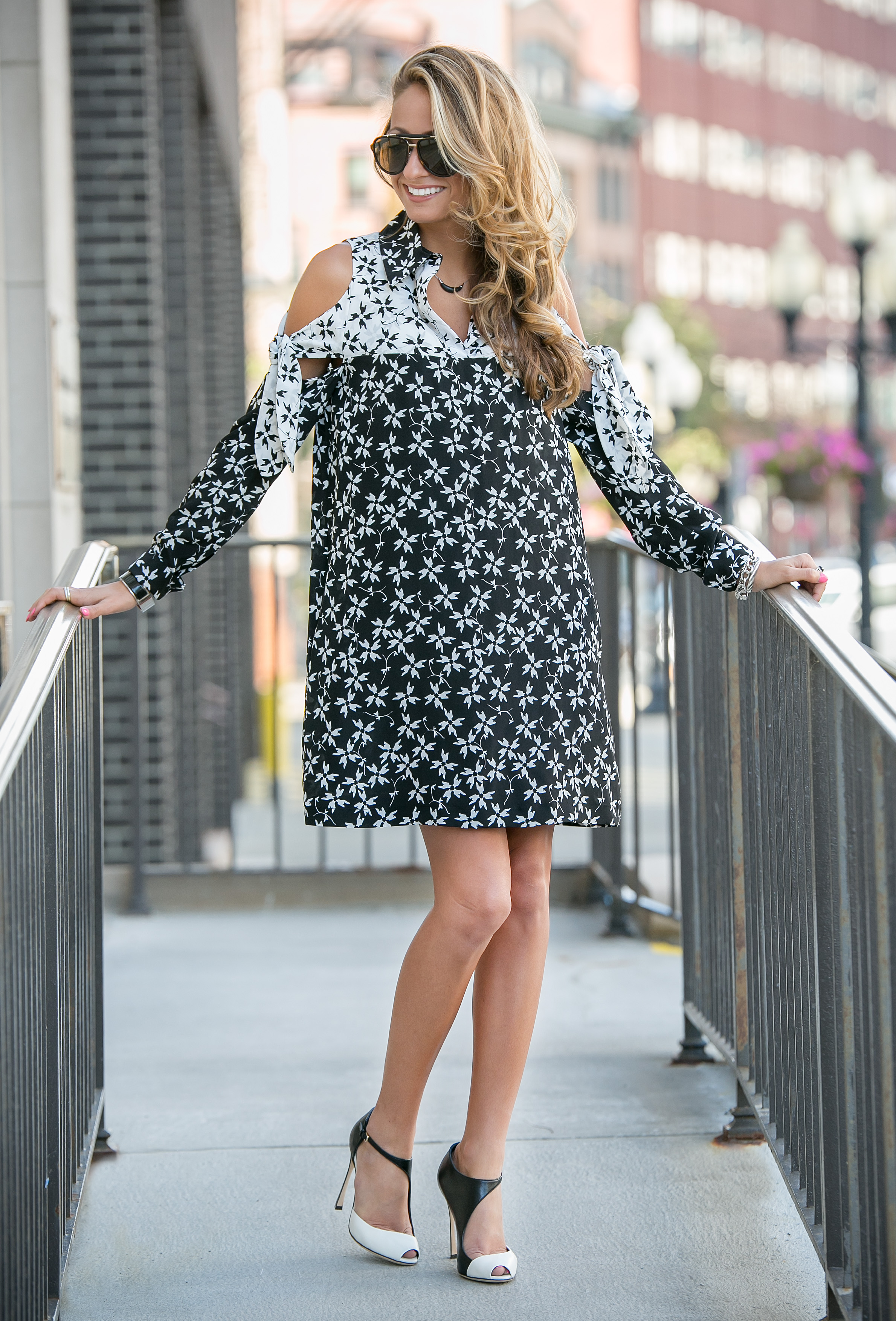 streetstyle blogger wearing a printed silk Tanya Taylor black and white dress with black and white pumps by Sergio Rossi