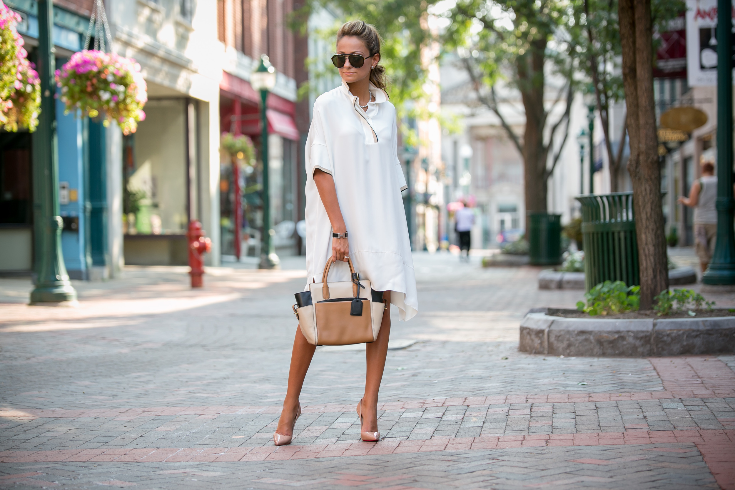 fashion blogger in an oversized dress