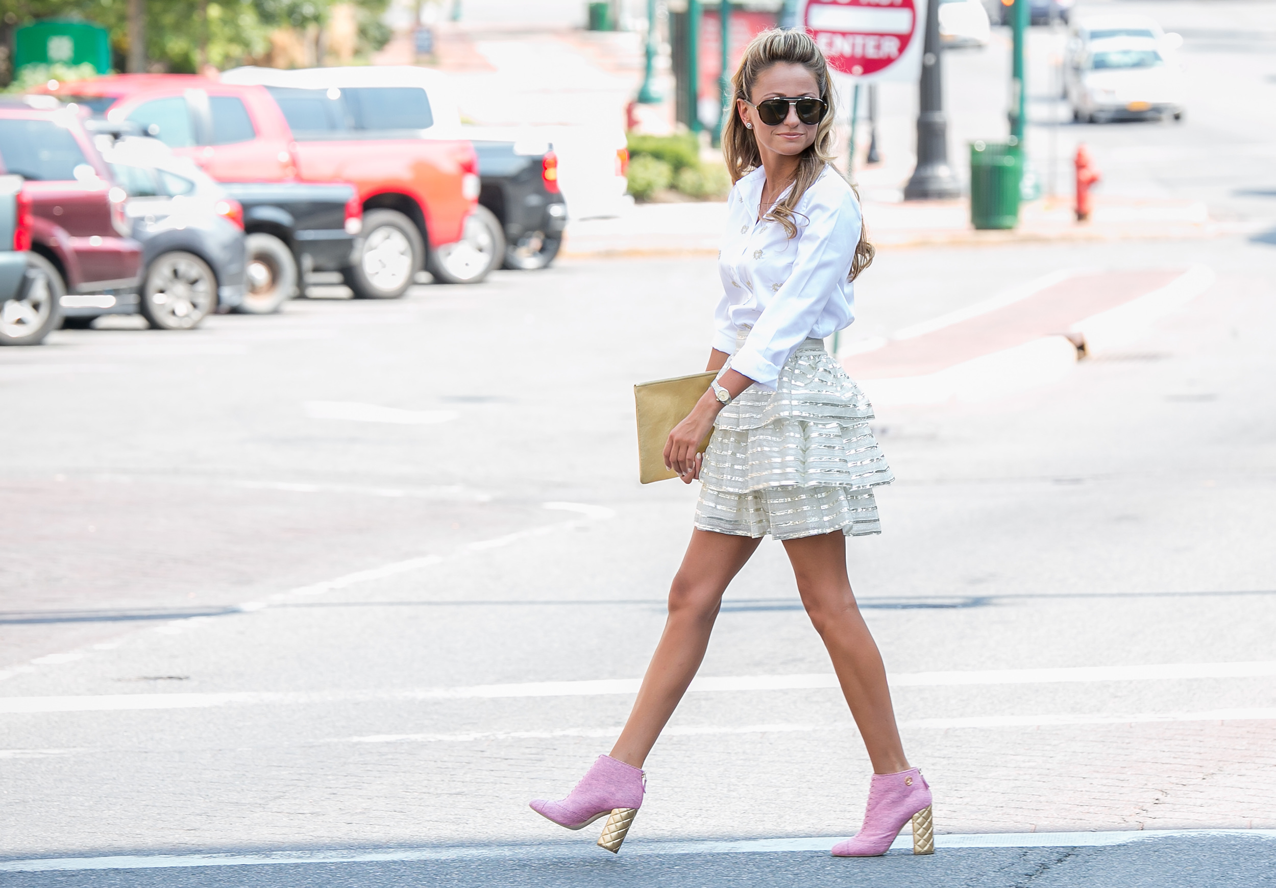 Street Style fashion blogger wearing Alice and Olivia Skirt, J.C.rew heart blouse, and Chanel Boots