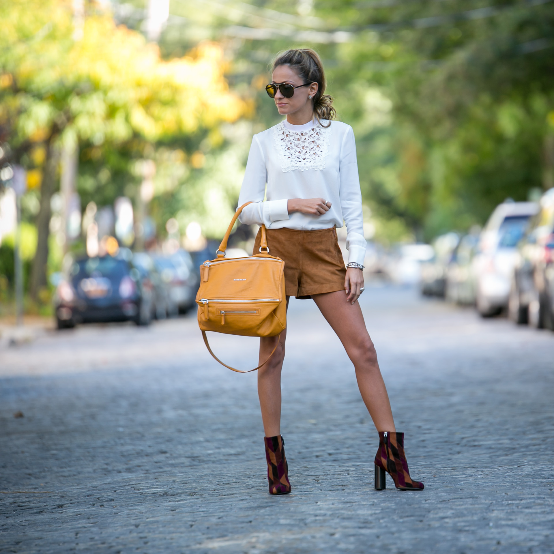 street style with A.L.C. lace blouse, Rag and Bone suede shorts, and Prada side patchwork ankle boots