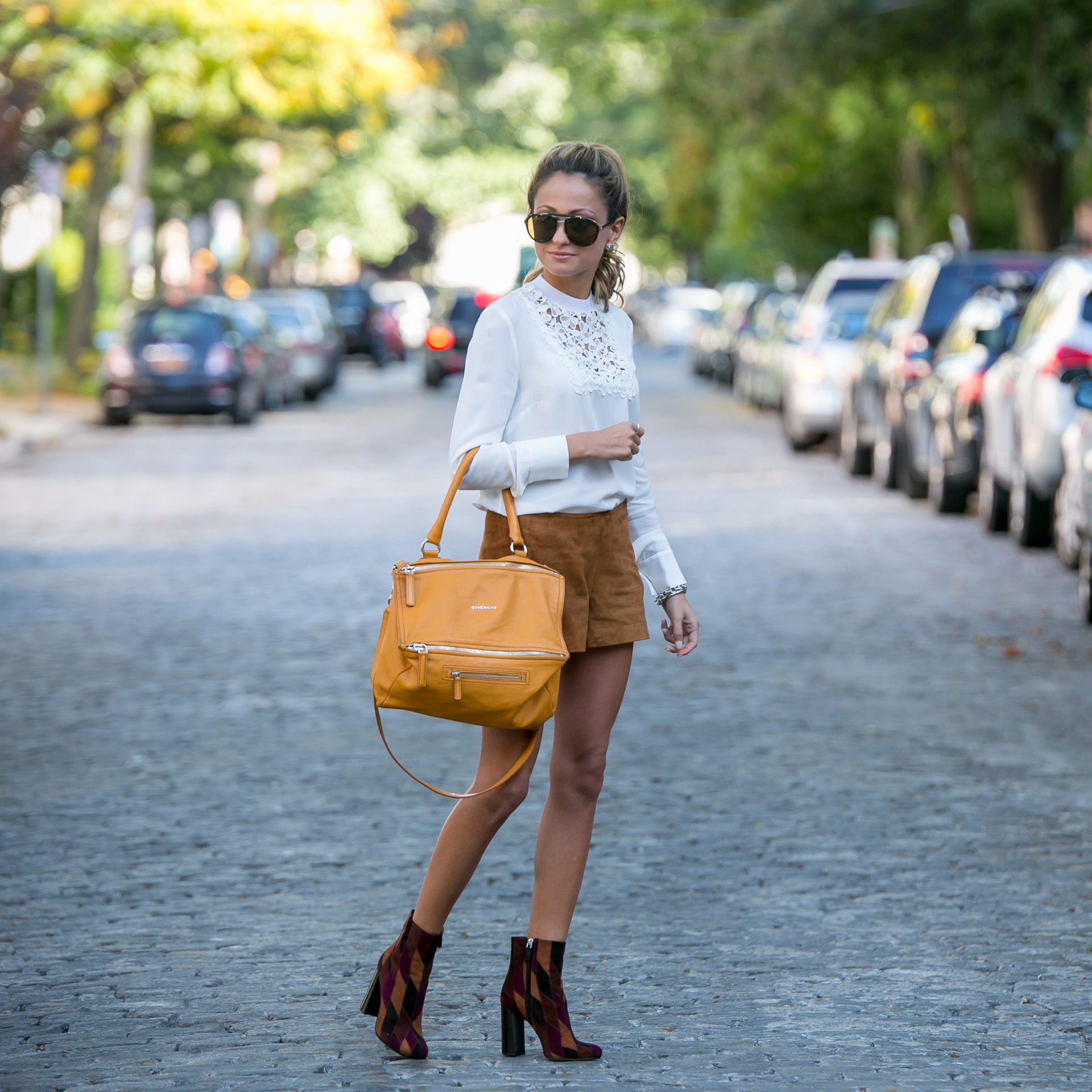 Suede trend. Wearing Rag & Bone suede shorts, A.L.C. lace blouse, and Prade sude patchwork ankle boots