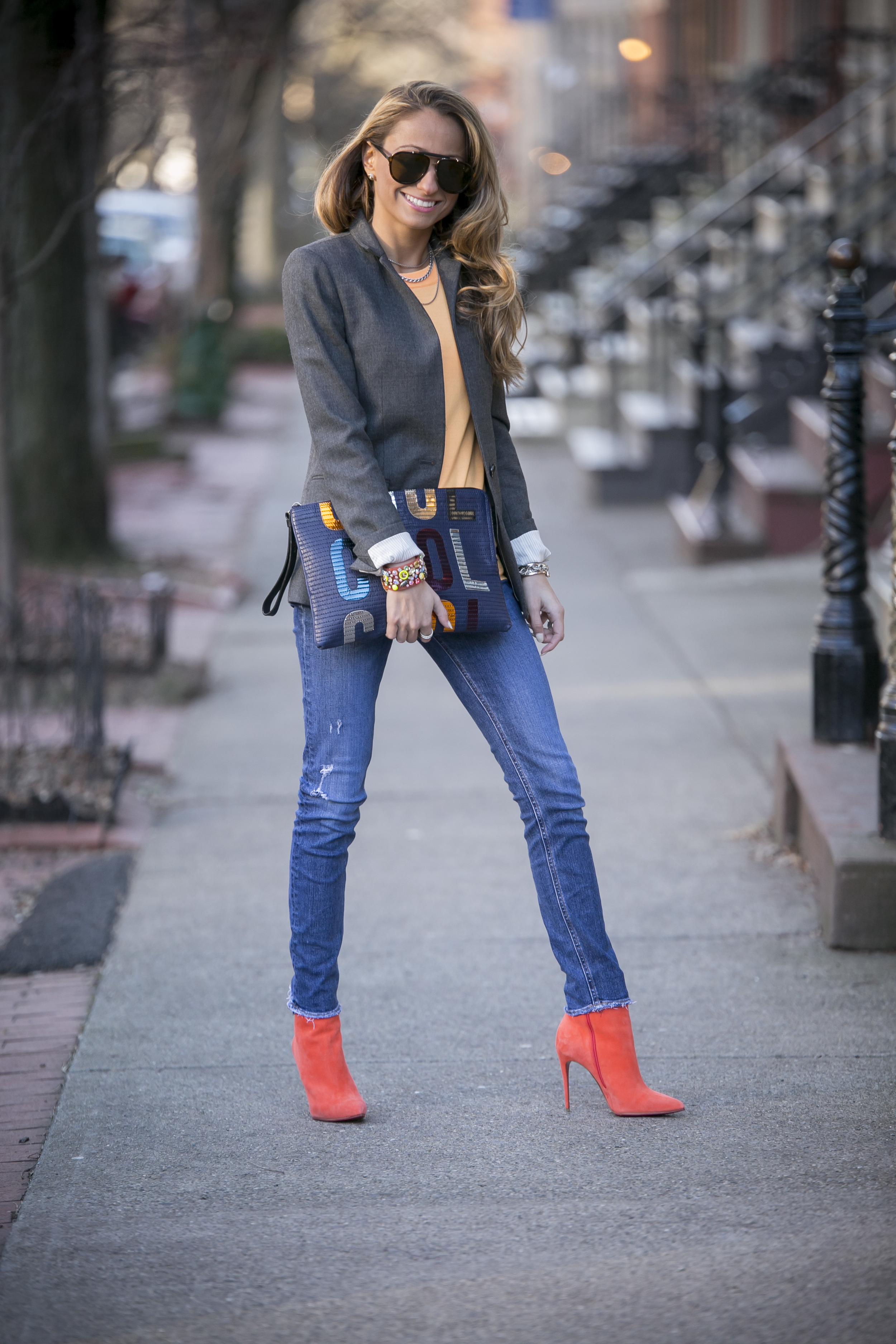 streetstyle blogger Lauren Recchia dressed in J.Crew sweater, J.Crew blazer, rag and bone jeans, and christian louboutin boots