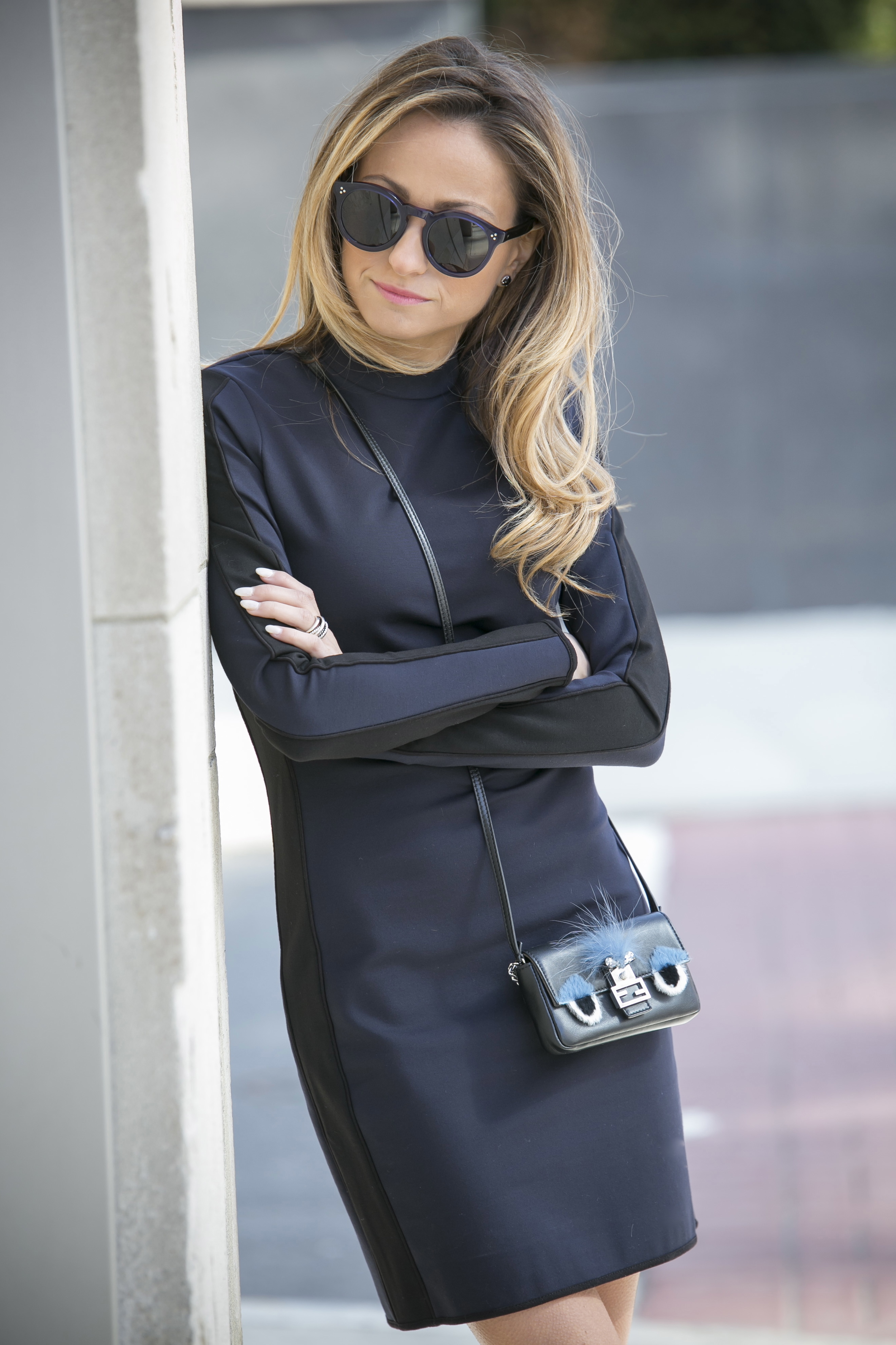 Illesteva sunglasses, rag and bone dress, fend bag for a streetstyle look on north of manhattan blogger