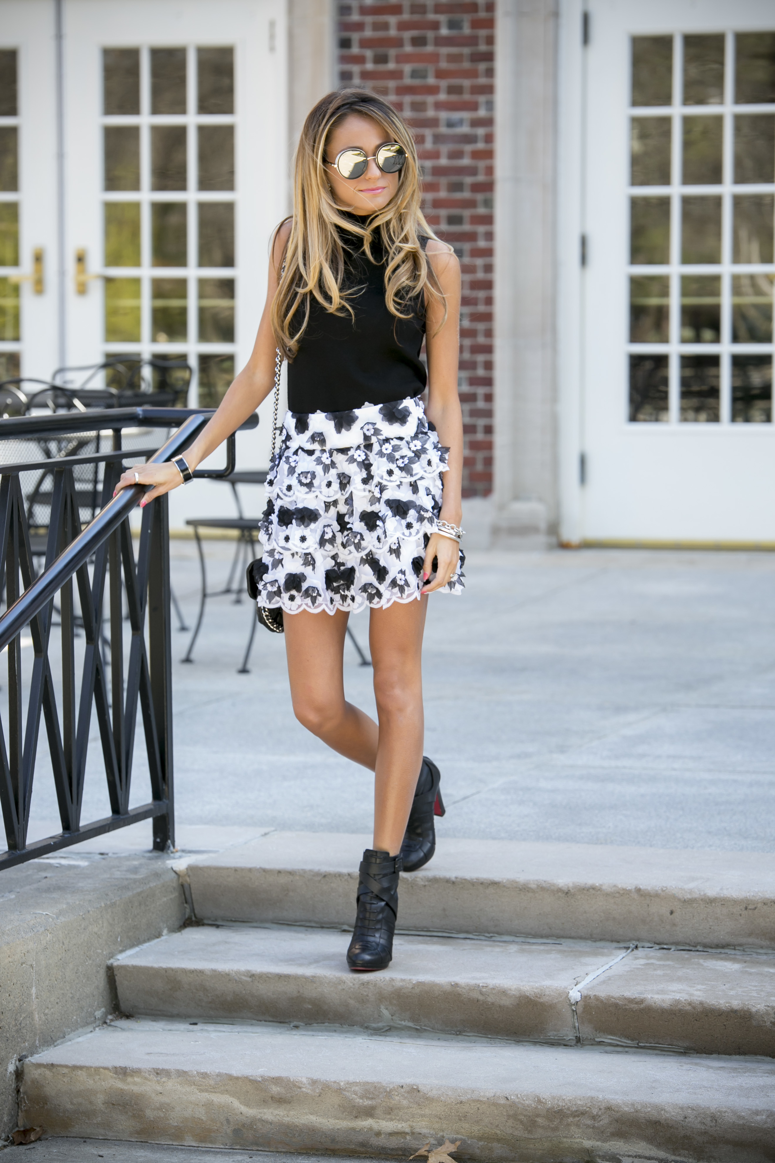 Milly knit top, Alice and Olivia skirt, and Christian Louboutin boots worn by Lauren Recchia for North of Manhattan fashion blog