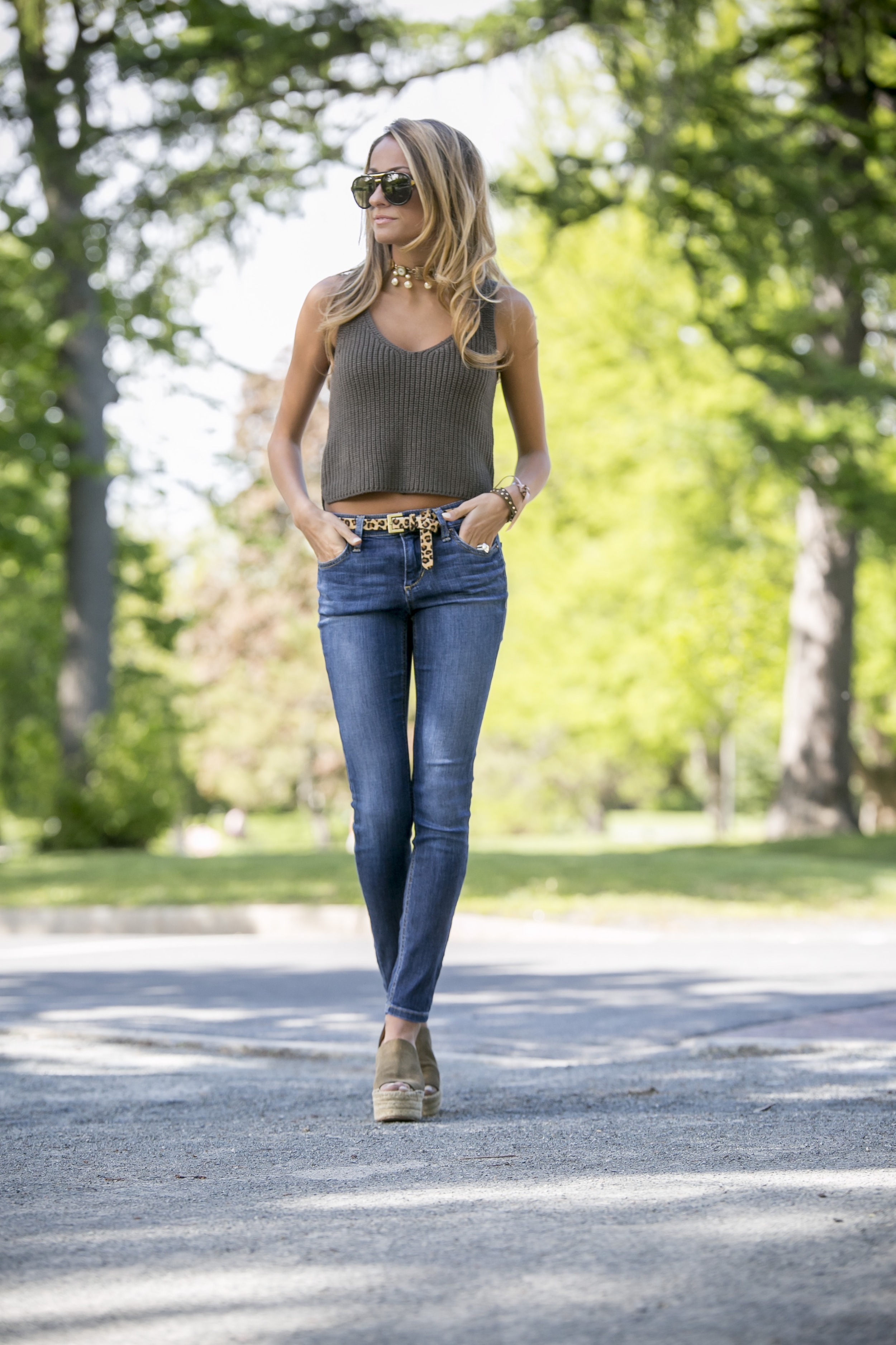 knit crop top exclusive for intermix from the intermix sale worn with jeans and olive green chloe wedges