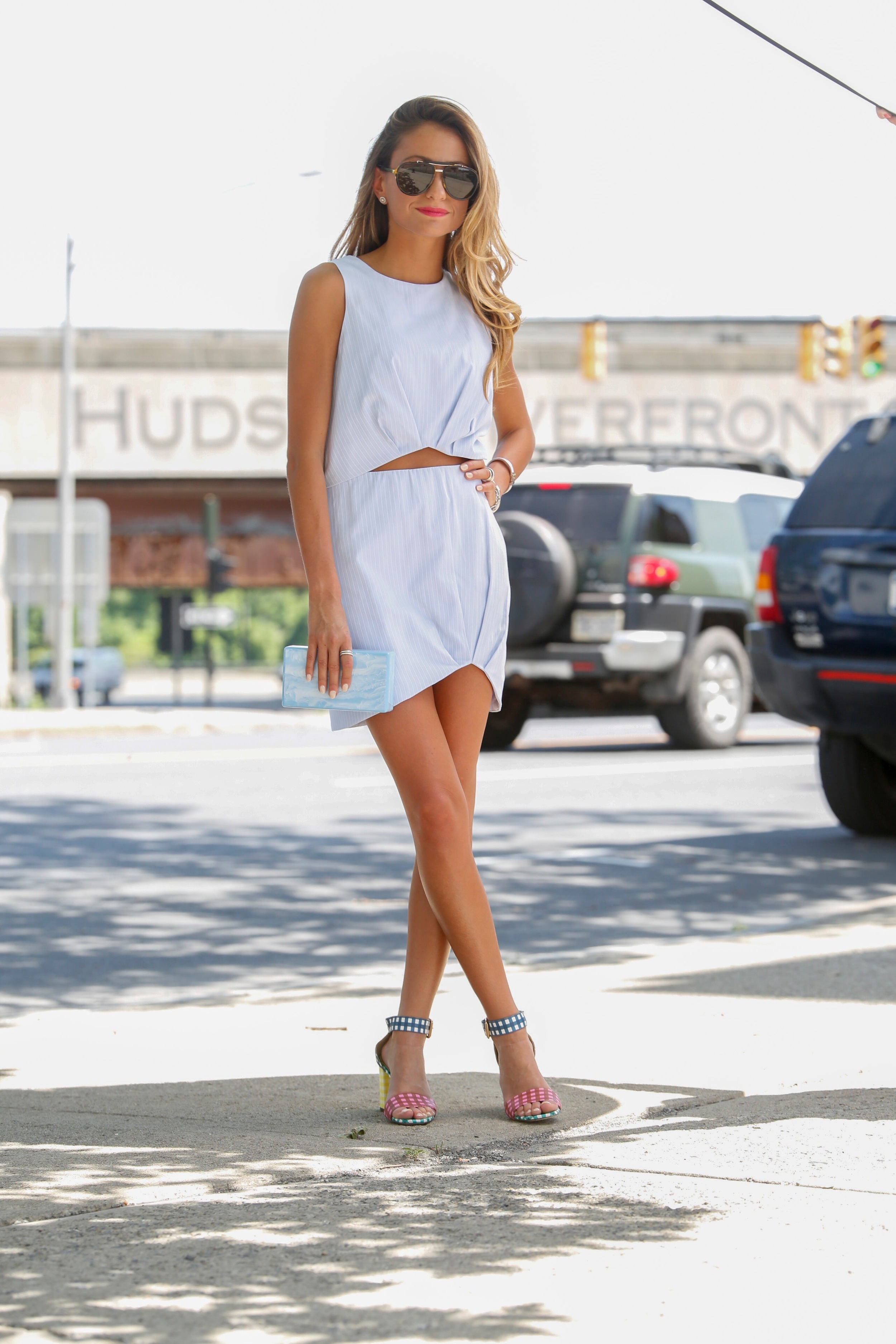 streetstyle fashion blogger seen in a matching set paired with an Edie Parker clutch and J.Crew gingham strappy sandals