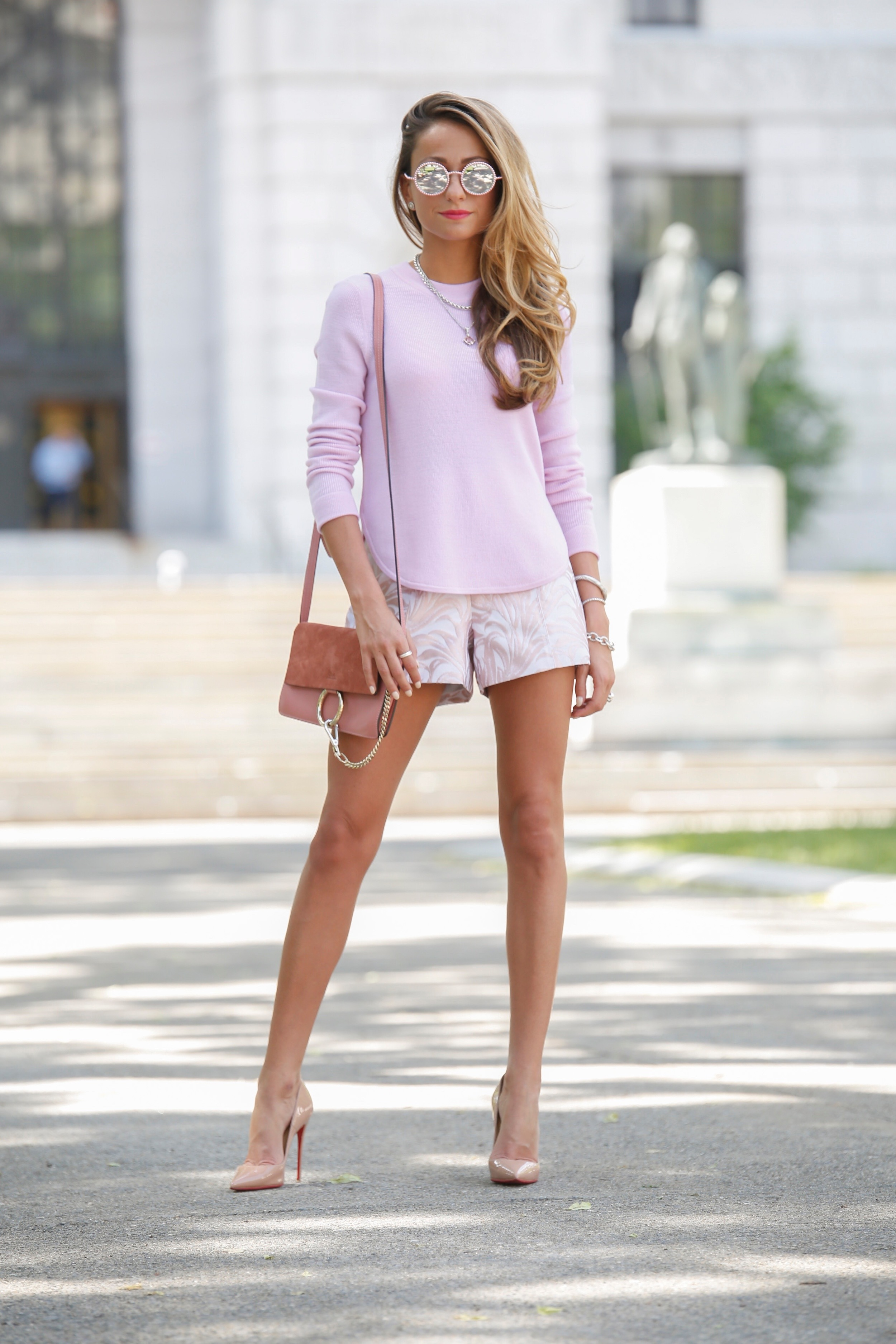 pink chanel sunglasses paired with an A.L.C. sweater and pink jacquard shorts exclusive for Intermix