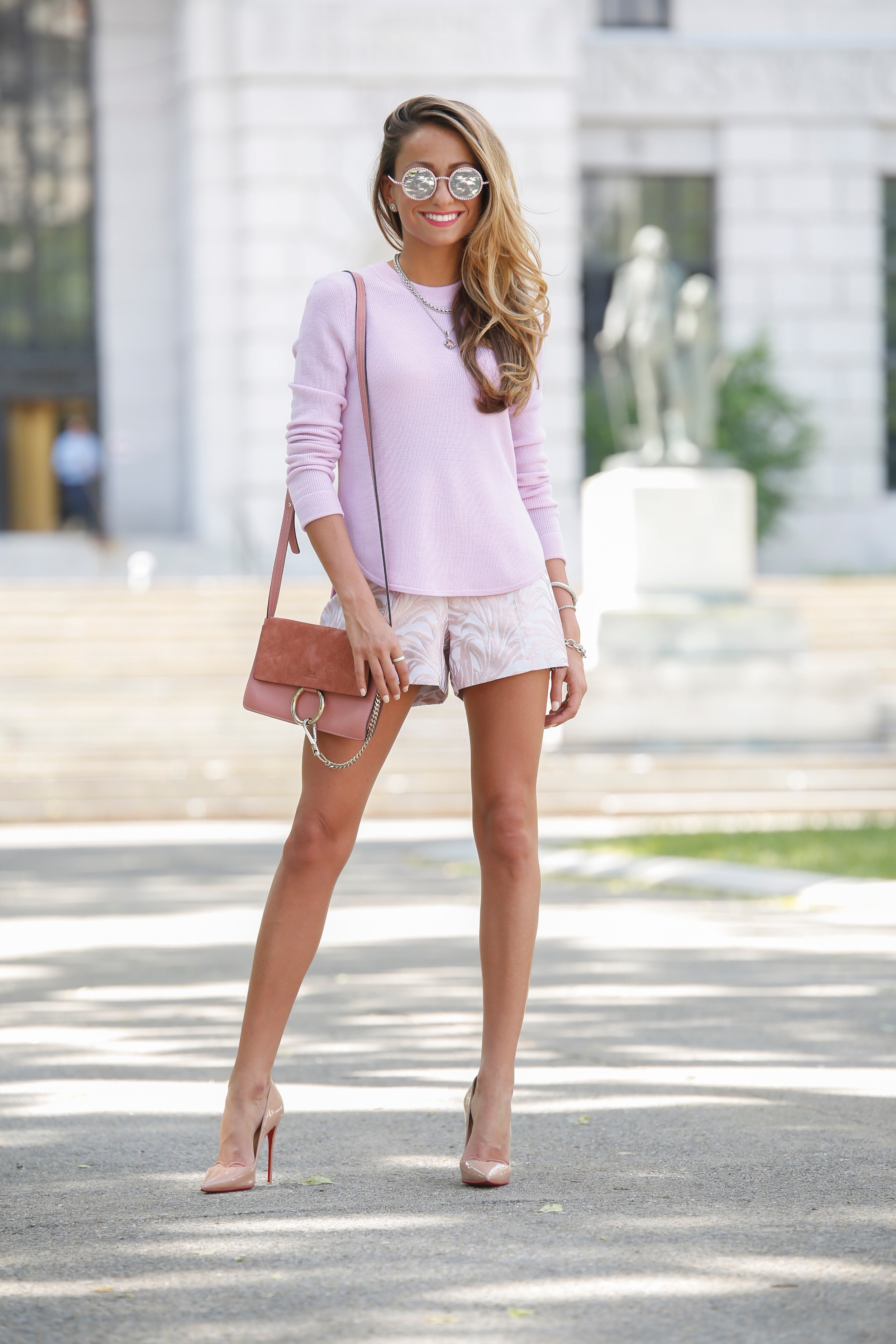 NYC fashion blogger Lauren Recchia seen in an A.L.C. sweater and pink jacquard shorts exclusive for intermix paired with the chloe faye bag and christian louboutin pumps