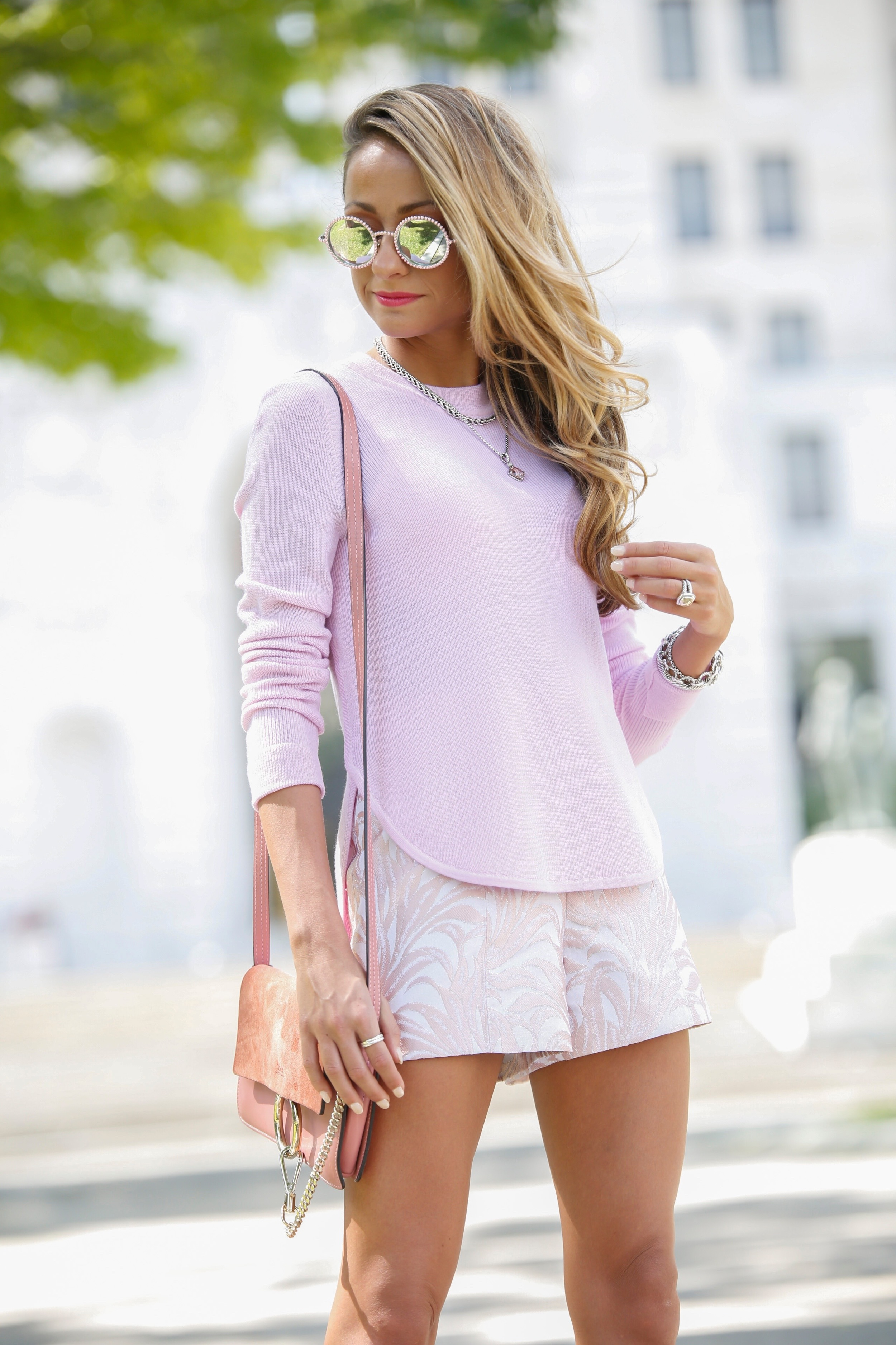 Pink chanel sunnies paired with an ALC knit and jacquard shorts