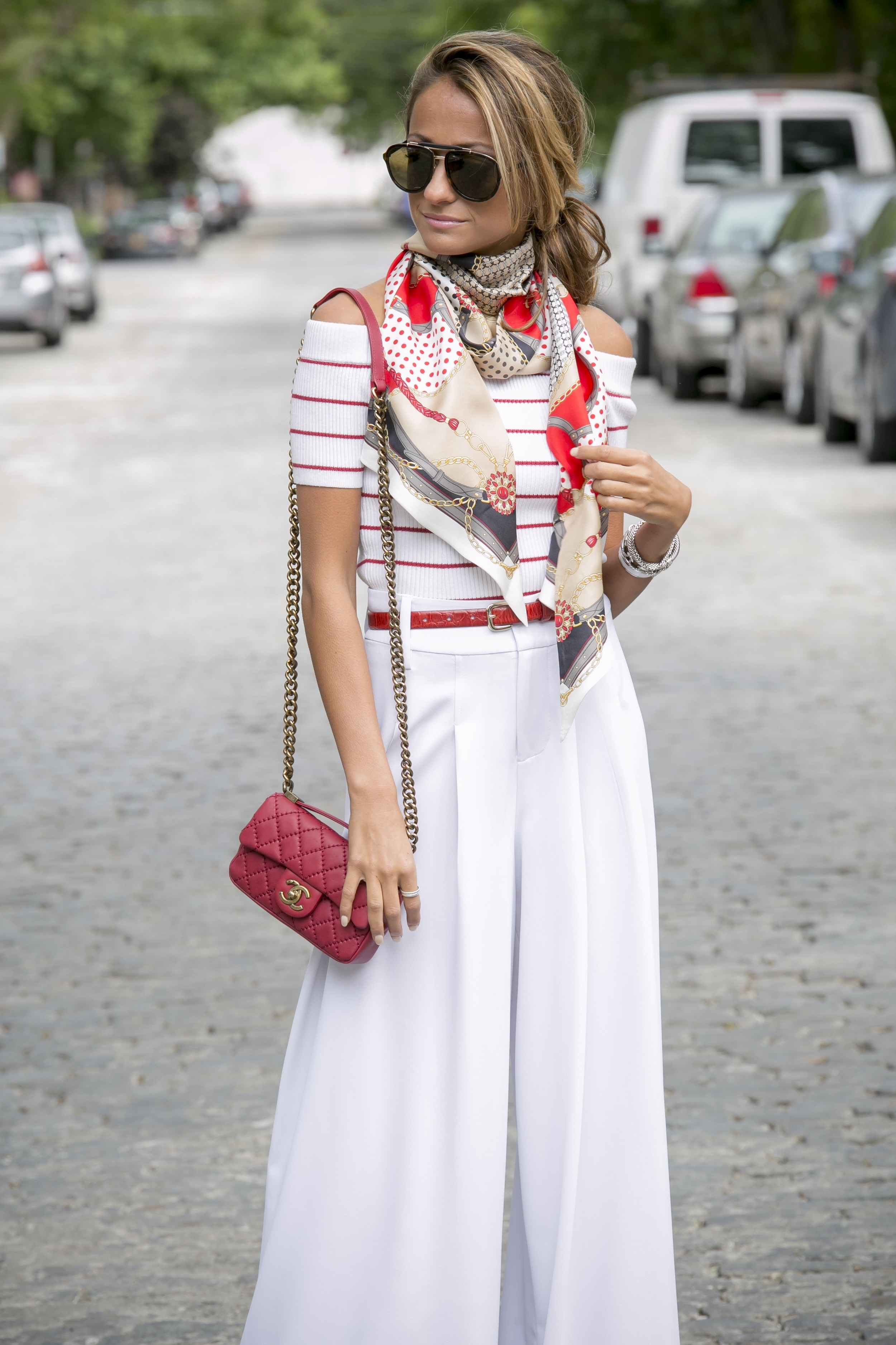 North of Manahttan in red threads featuring white Alice and Olivia wide leg trousers and the Zephine sweater from club monaco