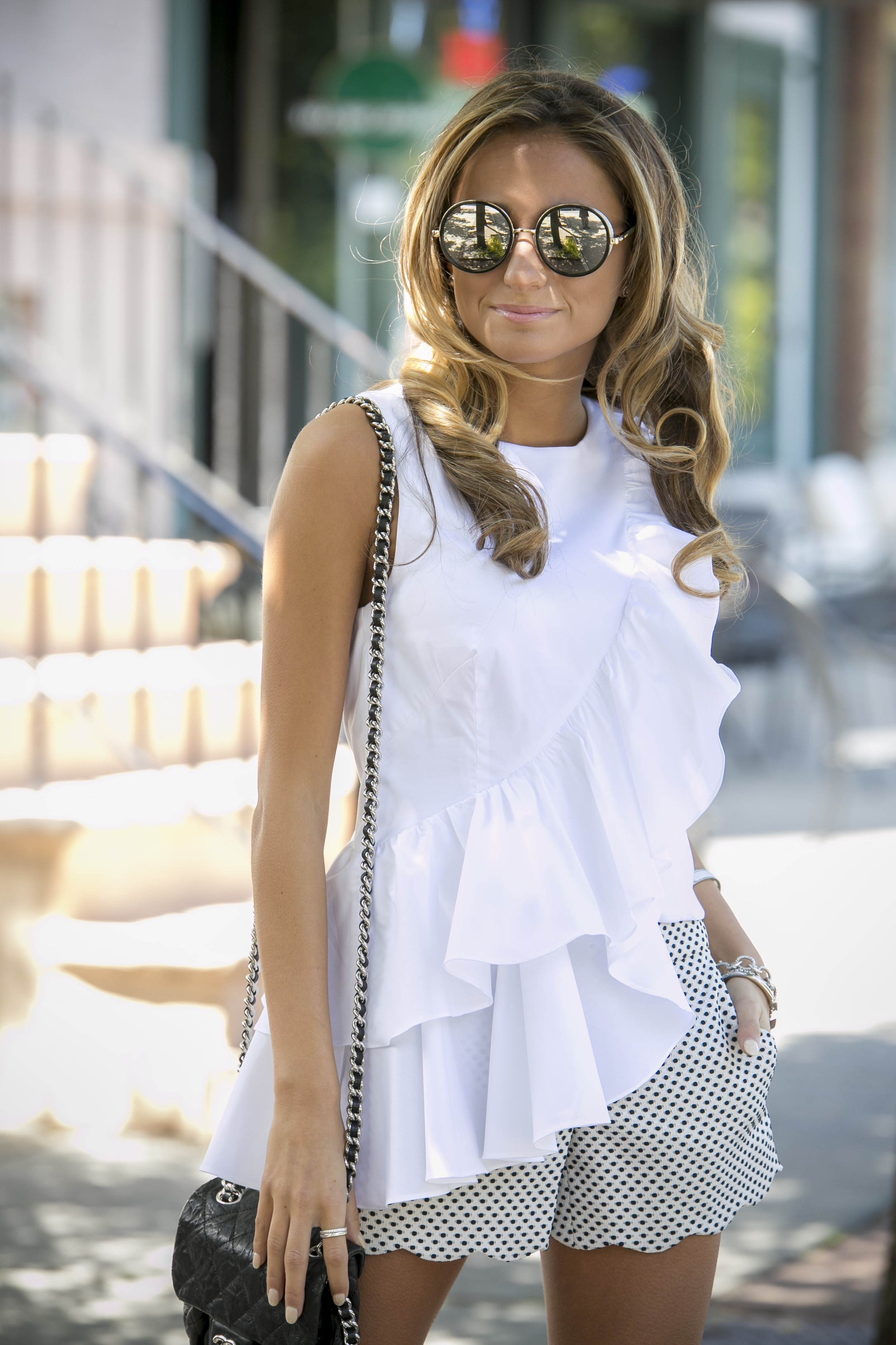 Jimmy Choo sunglasses on fashion blogger North of Manhattan seen wearing a ruffled top exclusive to Intermix