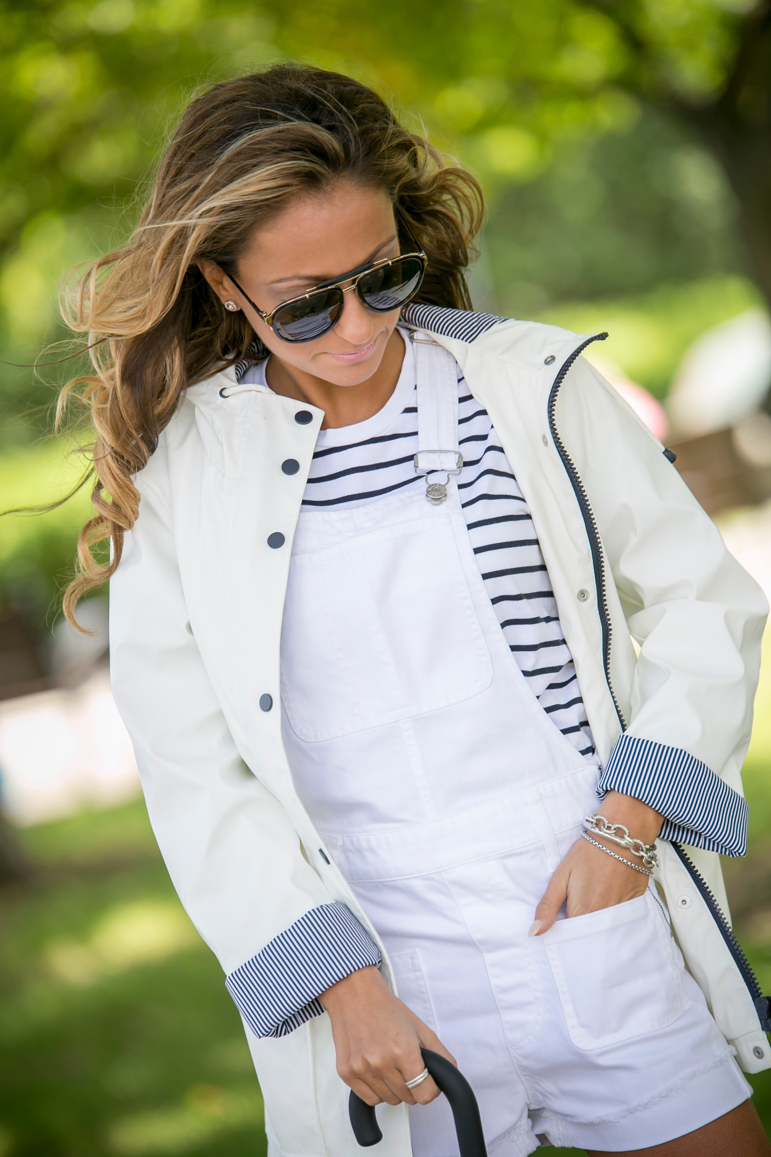 Topshop rain coat, rag and bone striped tee, and made well white short overalls as seen on Lauren Recchia from the NYC based fashion blog North of Manhattan