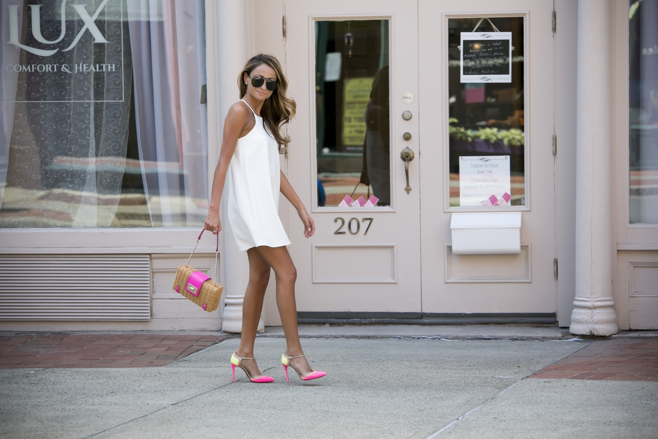 fashion blogger streetstyle in a white dress and pink statement pieces from kate spade and christian louboutin