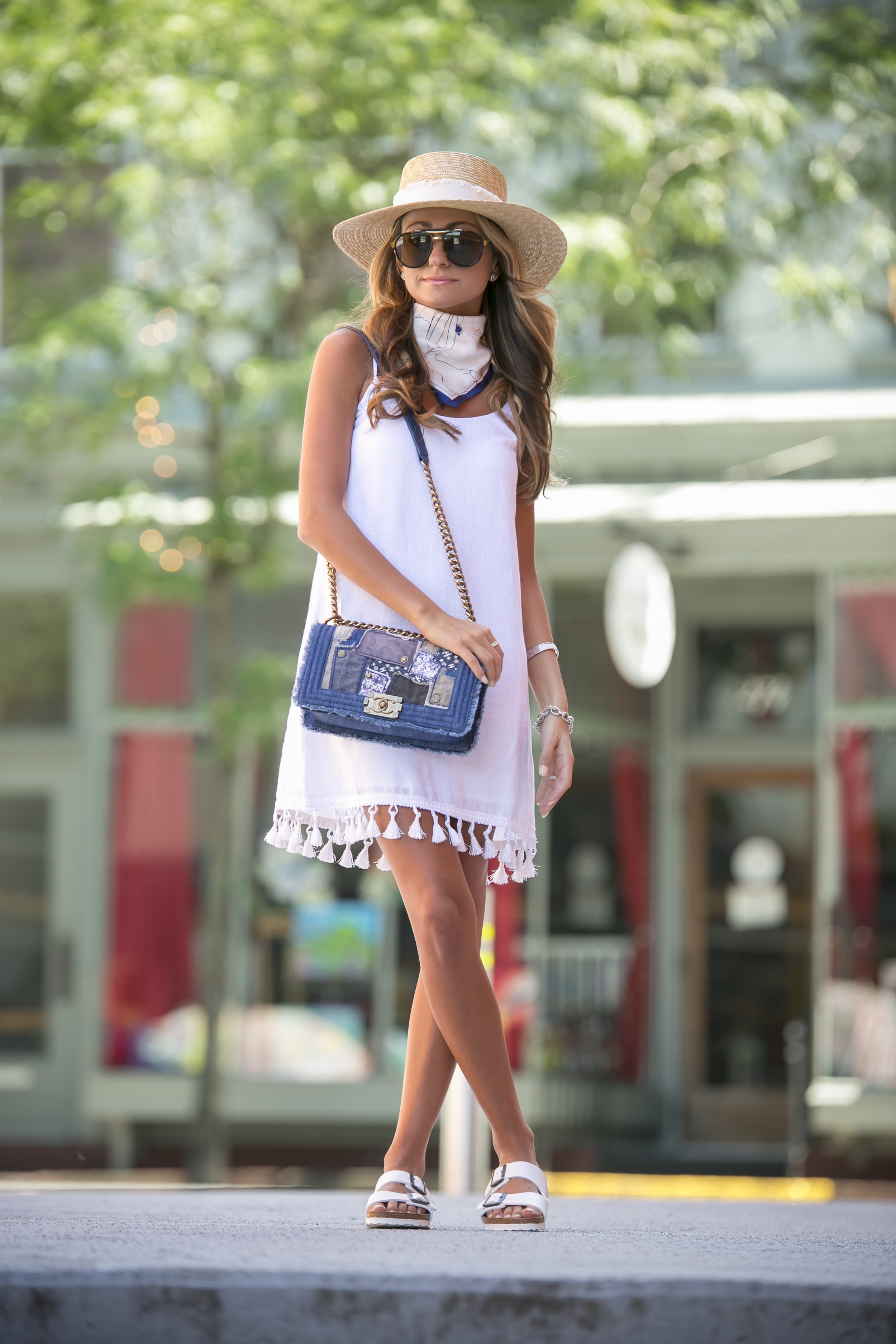 club monaco white tassel dress worn with a rag and bone boater hat and denim chanel bag for summer style