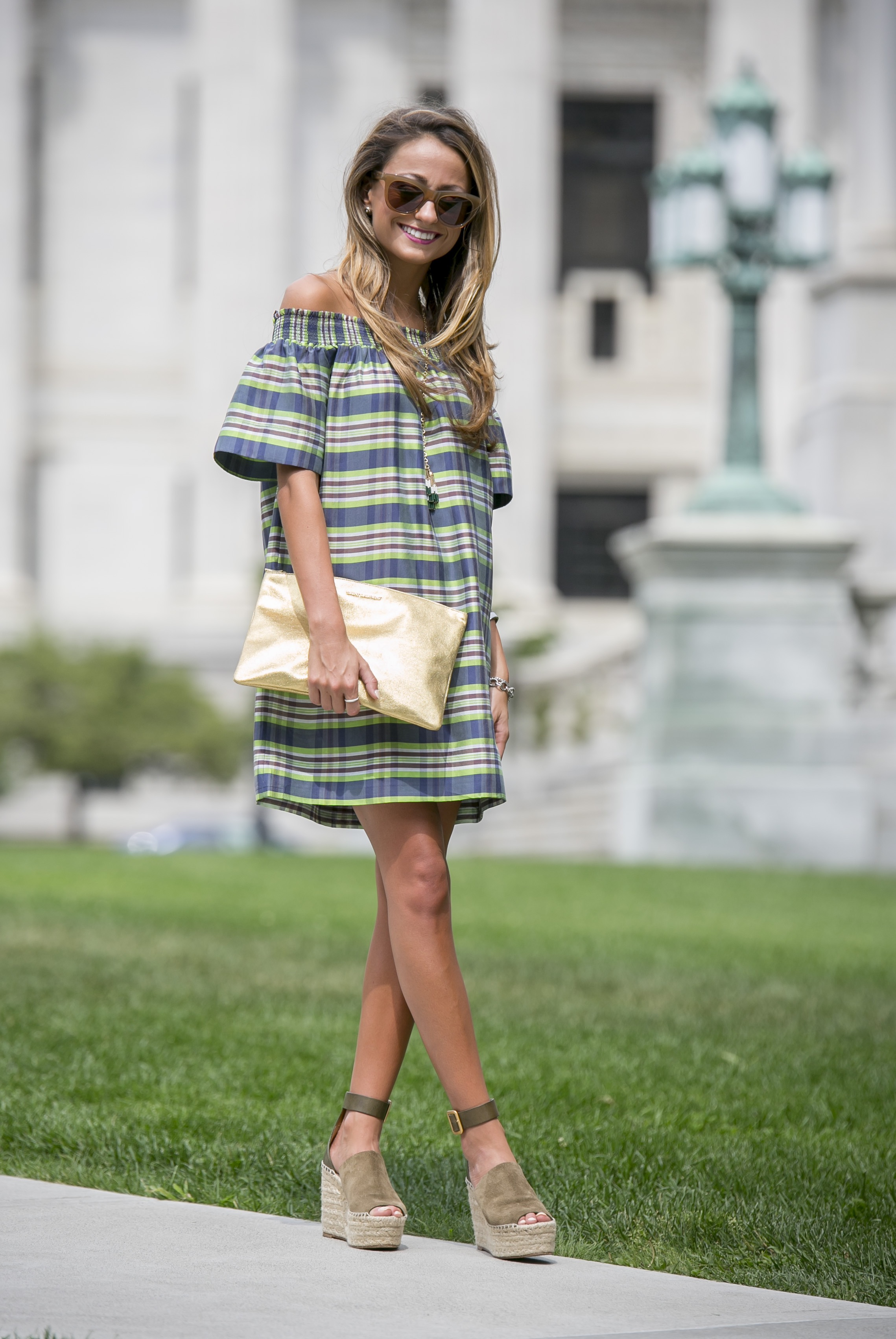 madras off of the shoulder dress paired with dramatic sunglasses and chloe espadrille wedges