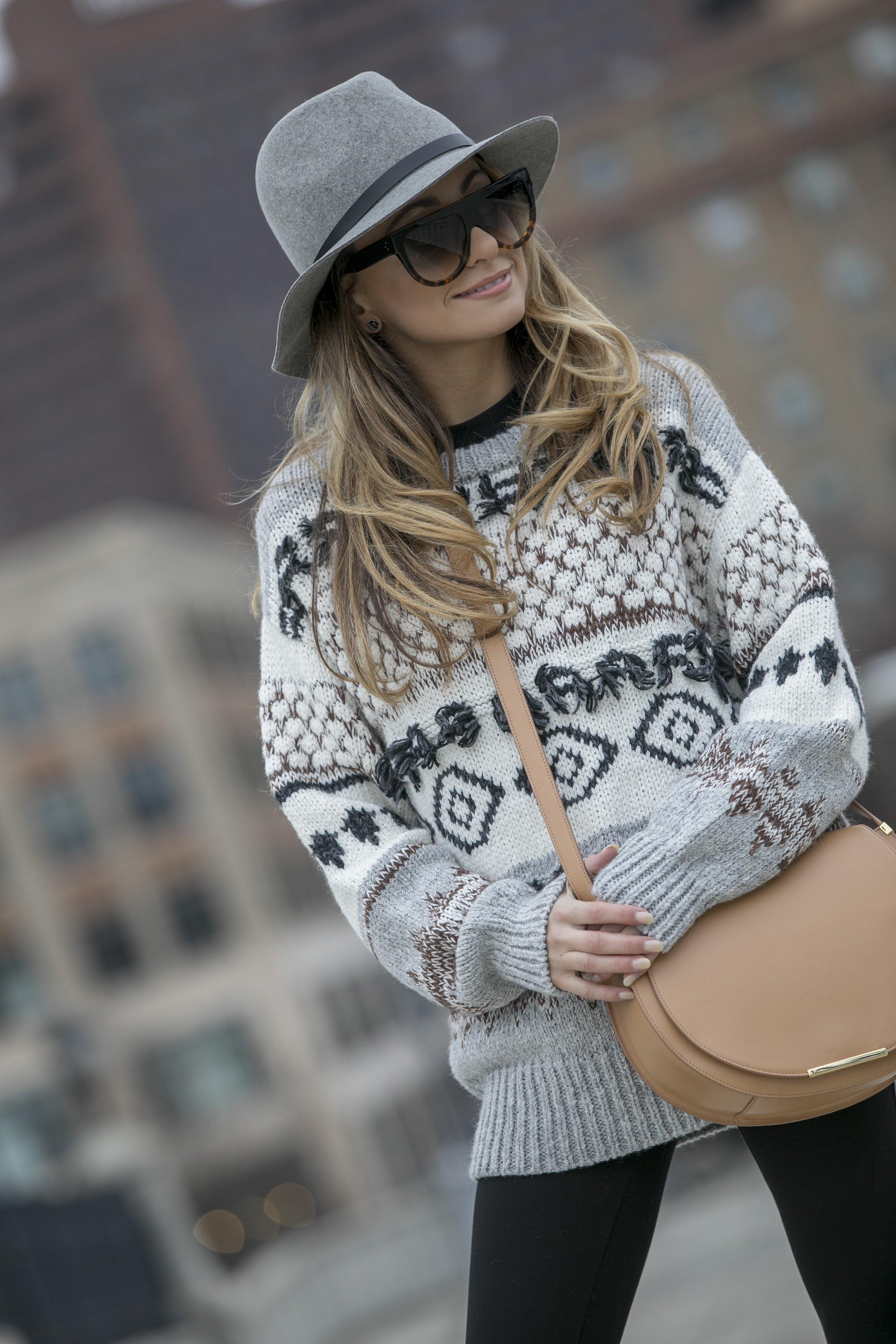 oversized sweater and floppy brim fedora