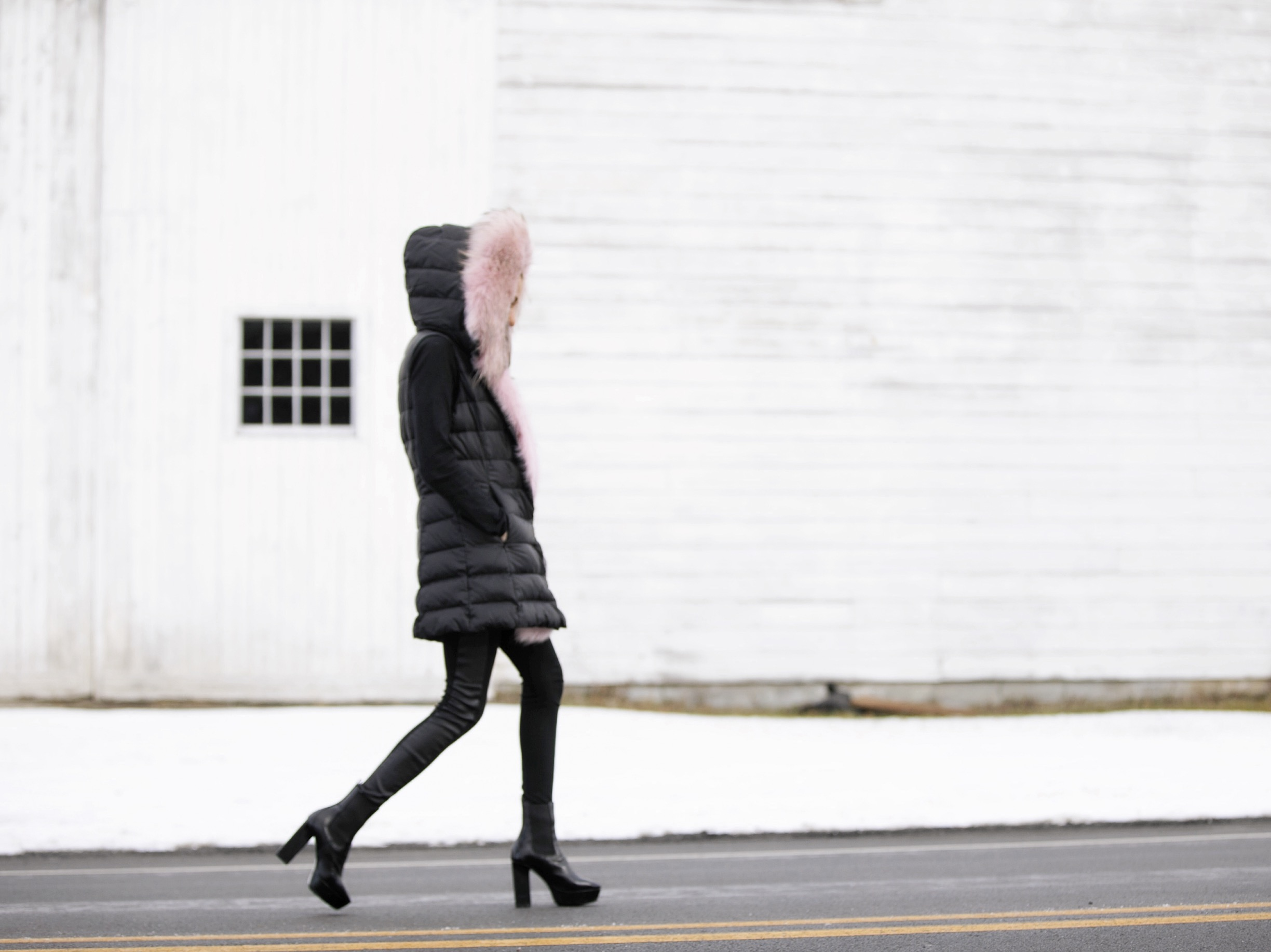 winter streetstyle and puffer vest by Dawn Levy and Saint Laurent boots