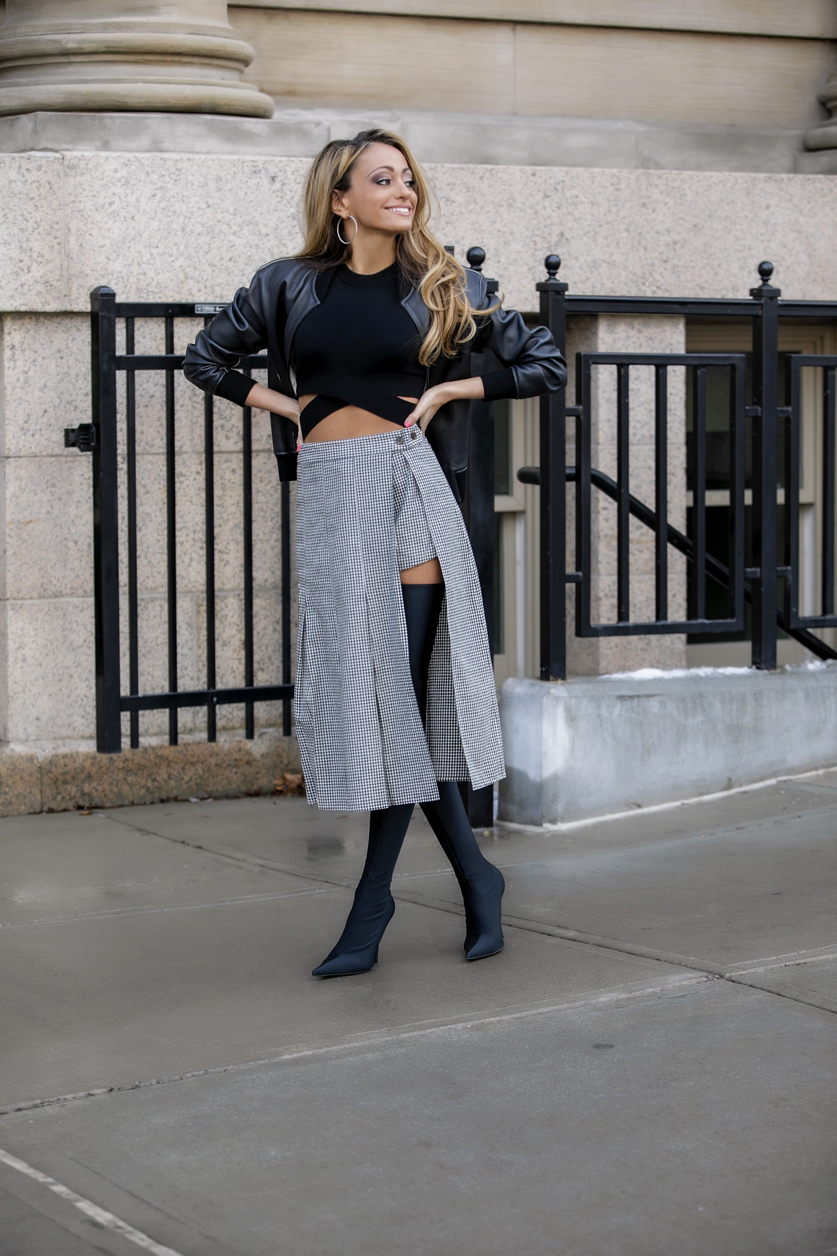 Lauren Recchia fashion week streetstyle in a Sandy Liang gingham skirt, Balenciaga boots, and a leather bomber jacket