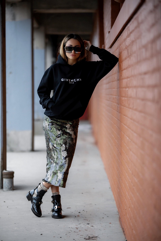 Lauren Recchia wearing Givenchy, Le Superbe California, Gucci socks, Balenciaga boots, and Saint Laurent sunglasses