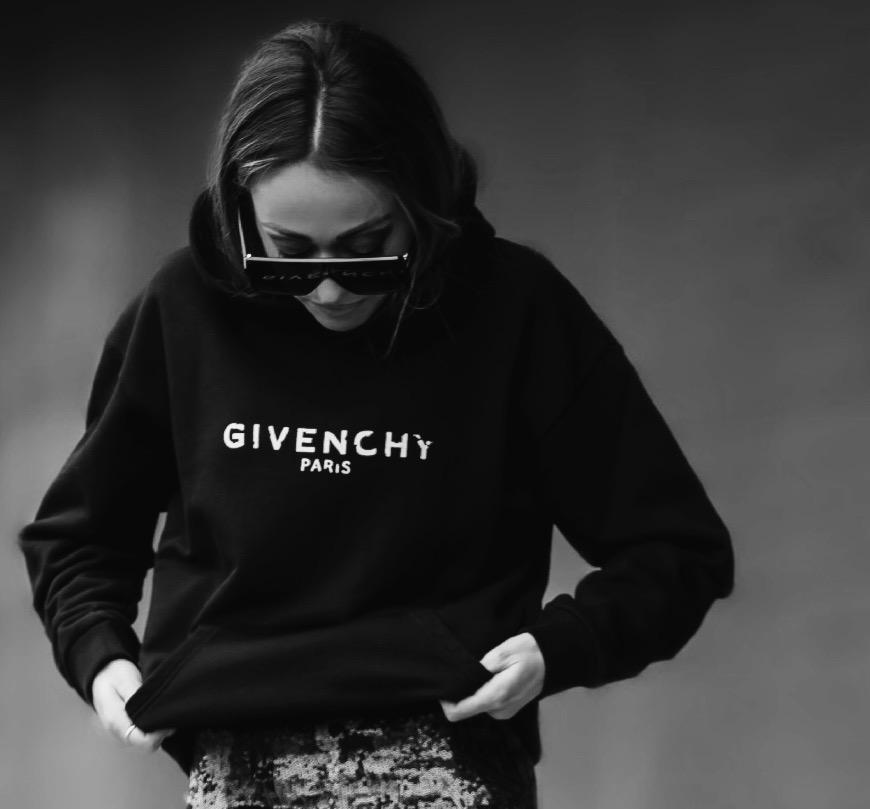 Hoodie: Givenchy |Skirt:  Le Superbe | Earrings:  Lana Jewelry |Sunnies: Saint Laurent |Socks: Gucci |Boots: Balenciaga     Dino Petrocelli Photography