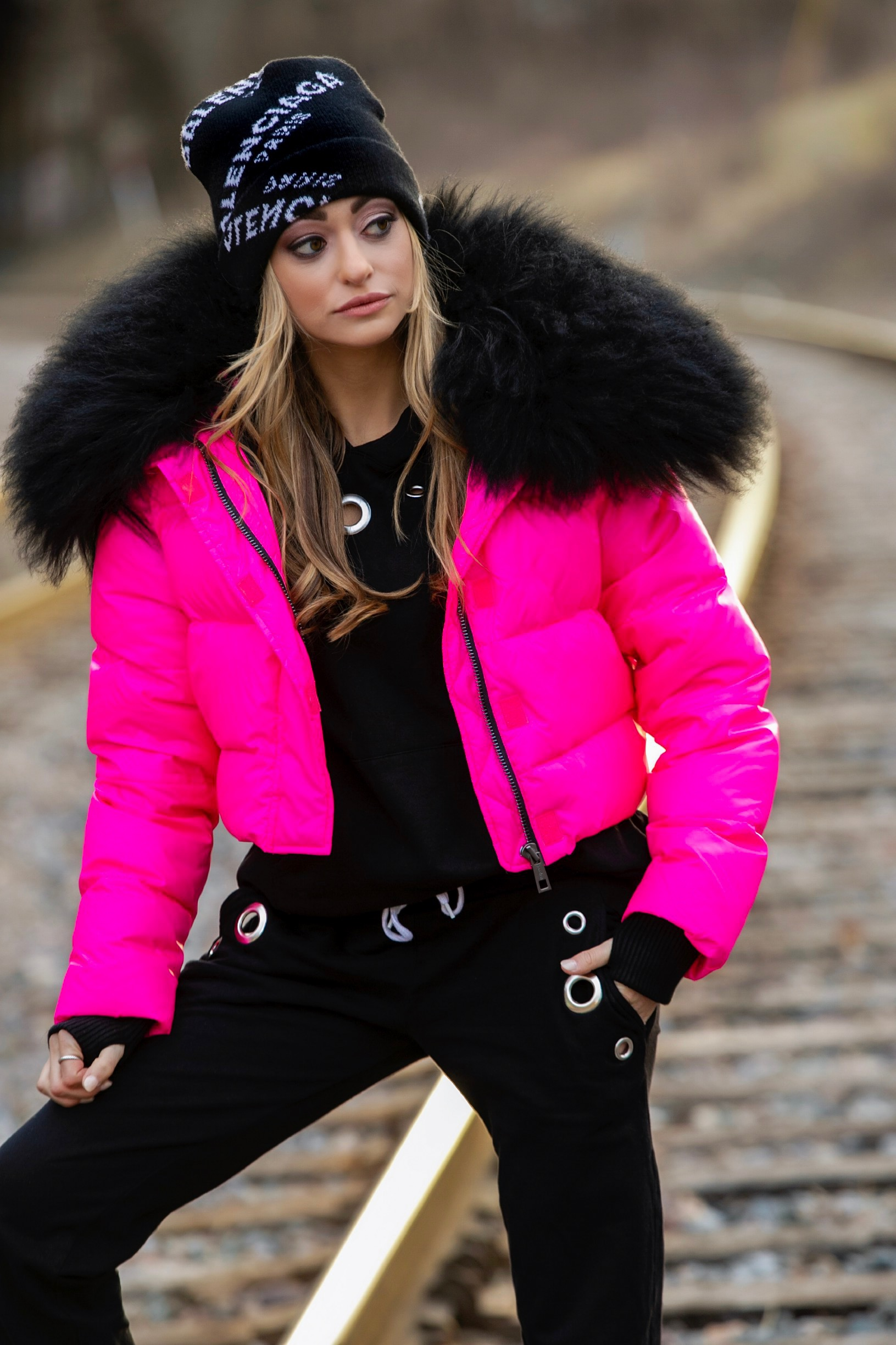 Jocelyn pink puffer jacket on Lauren Recchia styled with a Monrow sweatsuit and Balenciaga beanie