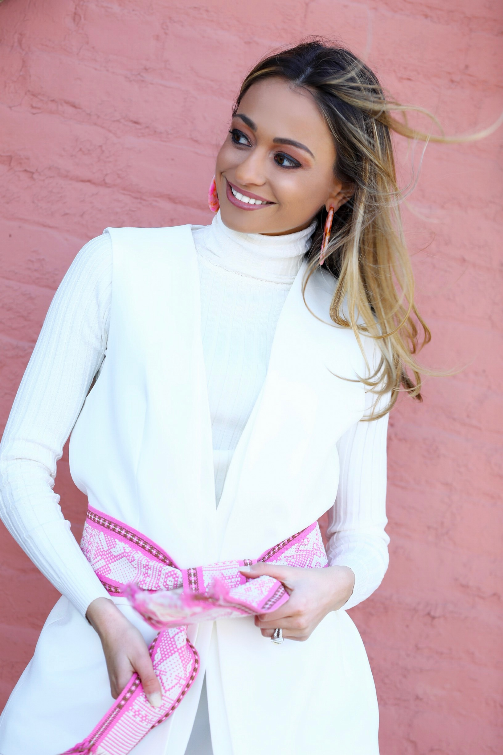 all white look with pink accessories