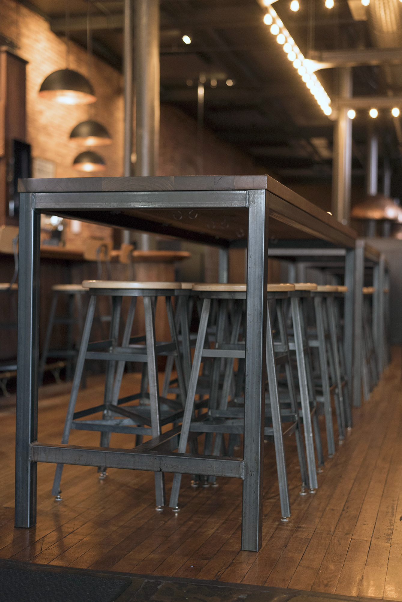 Custom Stools and Walnut Group Table at Pressroom Restaurant