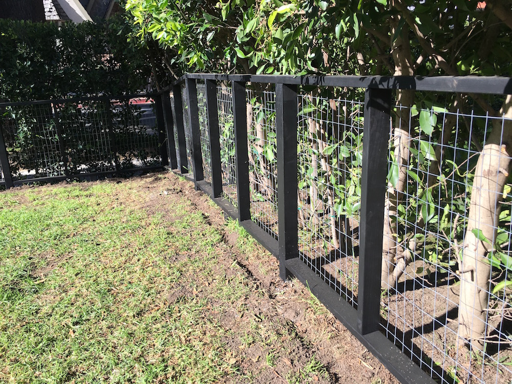 Wire mesh and redwood fence - Brentwood, ca.jpg