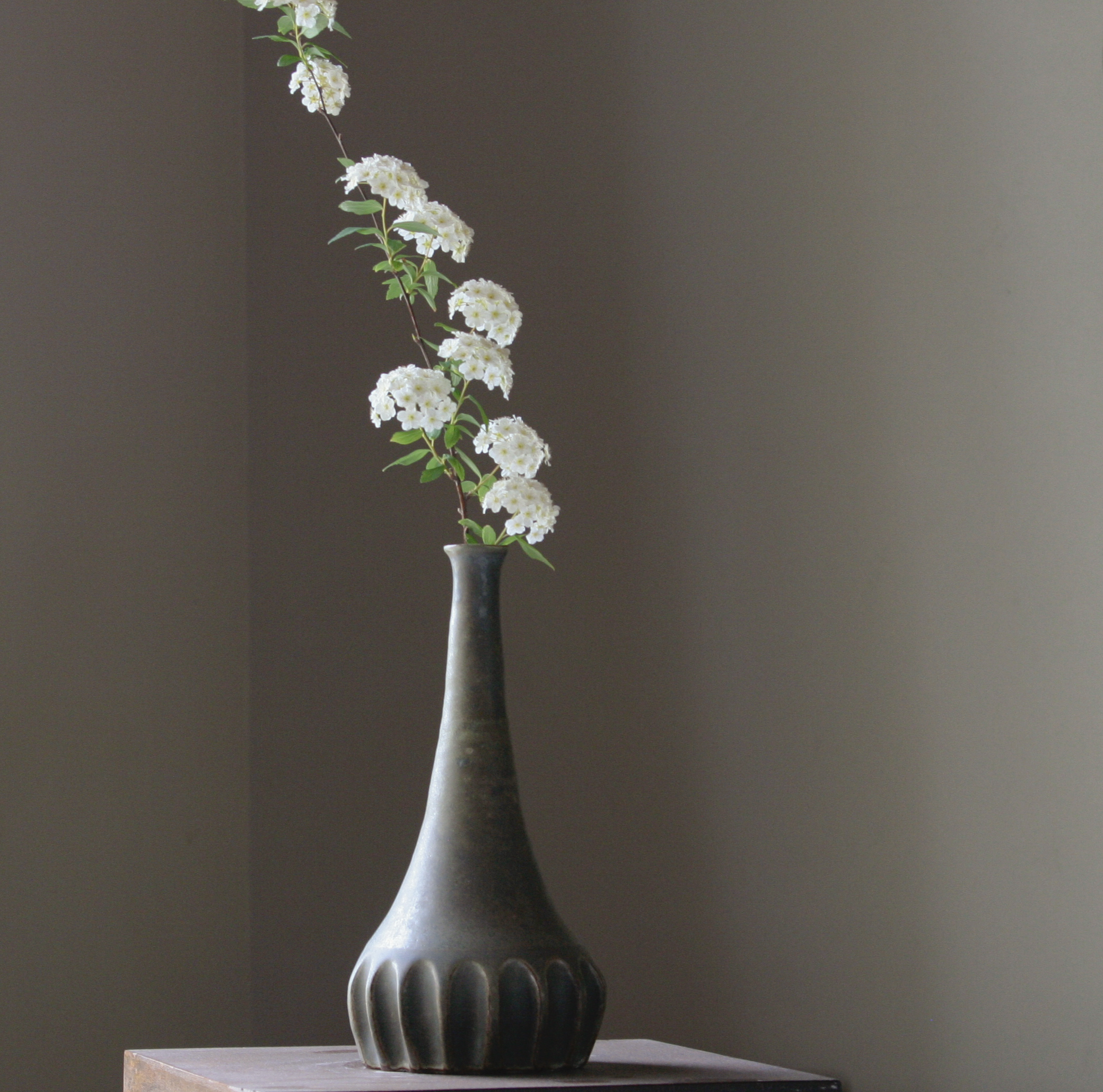 Tall, carved vase by D Pottery