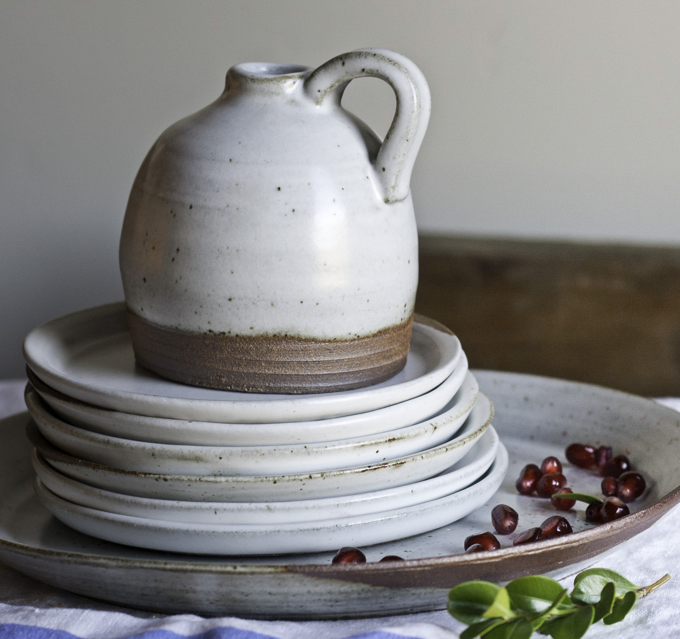 little jug and stack of plates.JPG