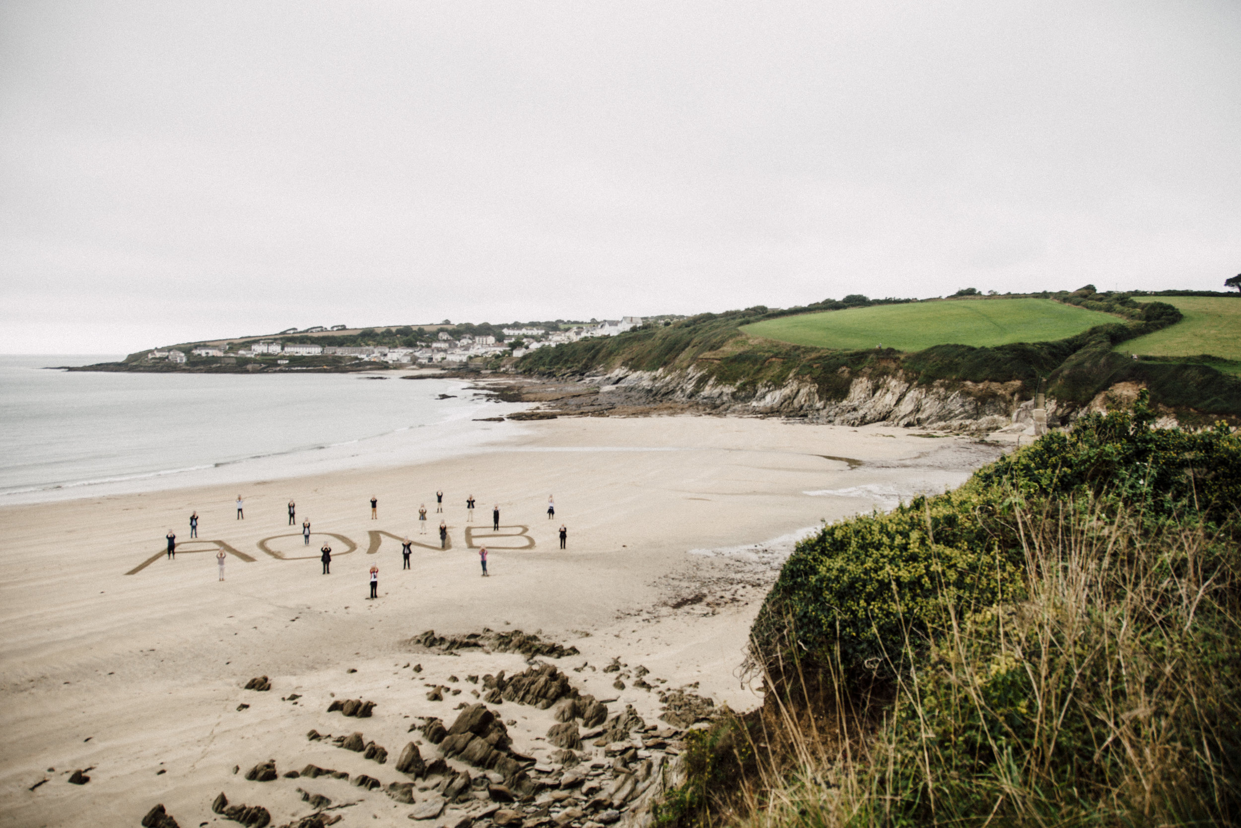 AONB Partners celebrate the Management Plan launch at Porthcurnick beach - all images by Emma Coster.