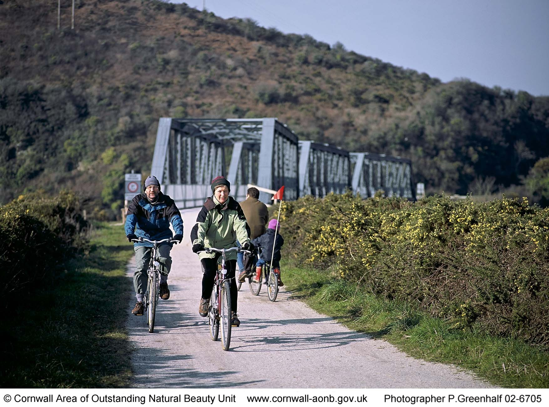 03 Cyclists with iron bridge behind - Camel Trail.JPG