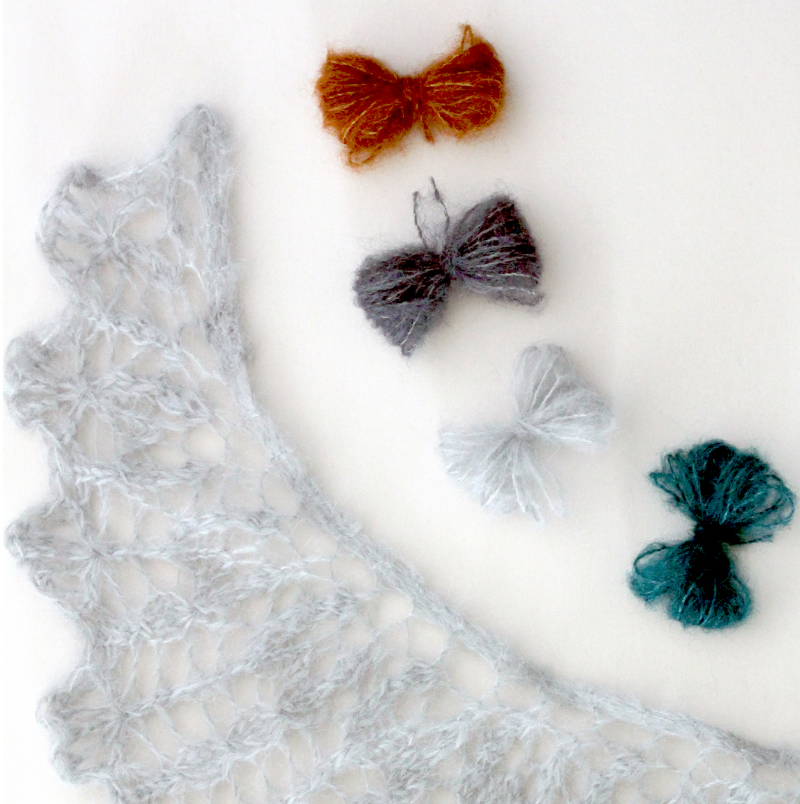 Shawl shown in #911/Silver, yarn butterflies shown in #902/Rust, #931/Slate, #911/Silver and #904/Teal