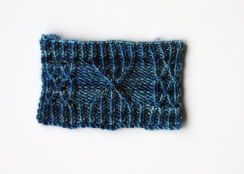 Cabled and twisted stitch swatch knitted in #608/Blue Lagoon, knitted on 2.5mm needles