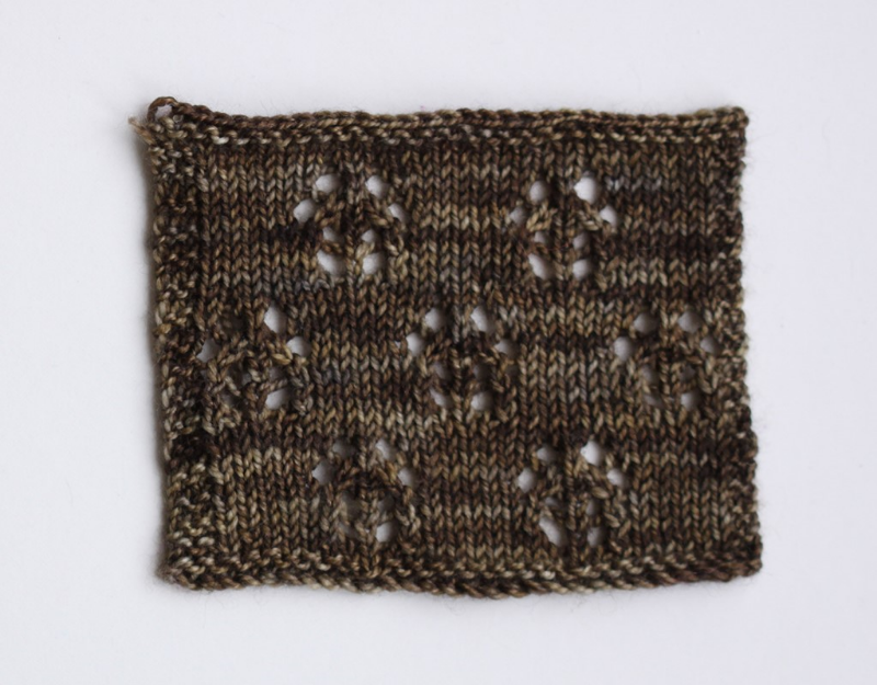 Lace swatch knitted in #603/Silver and Bronze, knitted on 3.25mm needles