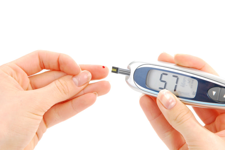 person checking blood sugar.jpg