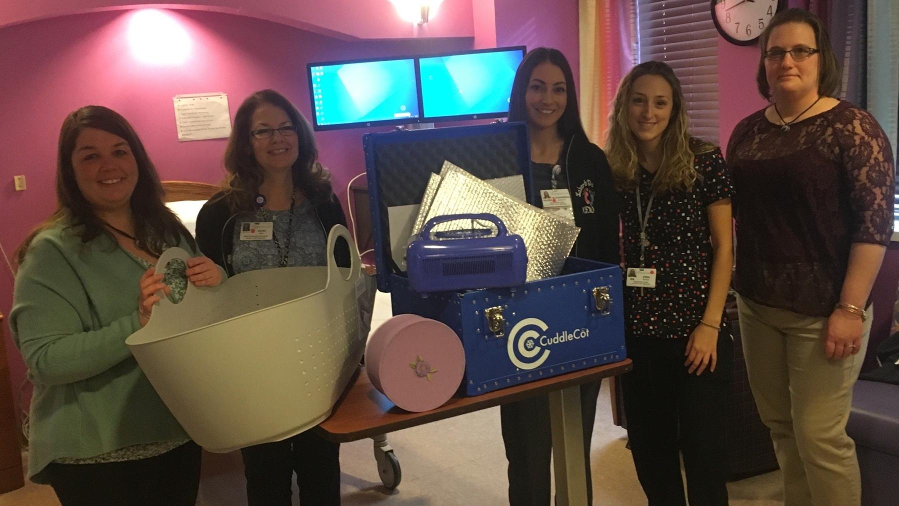 Niagara Memorial Hospital presentation of cuddle cot and Moba basket.