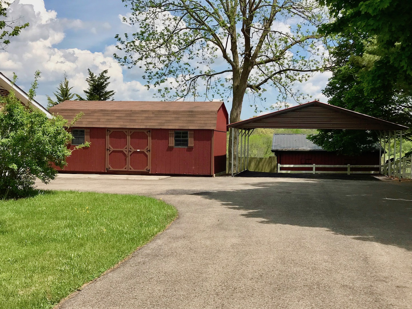 Exterior-Driveway showing Carport and Storage Shed.jpg