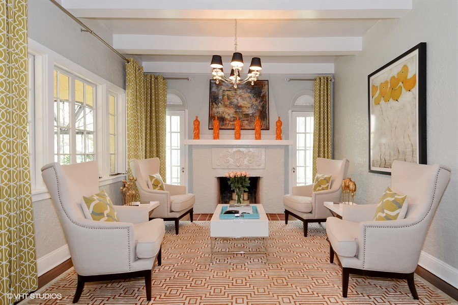 Living Room with soaring wood-beamed ceilings and fireplace.