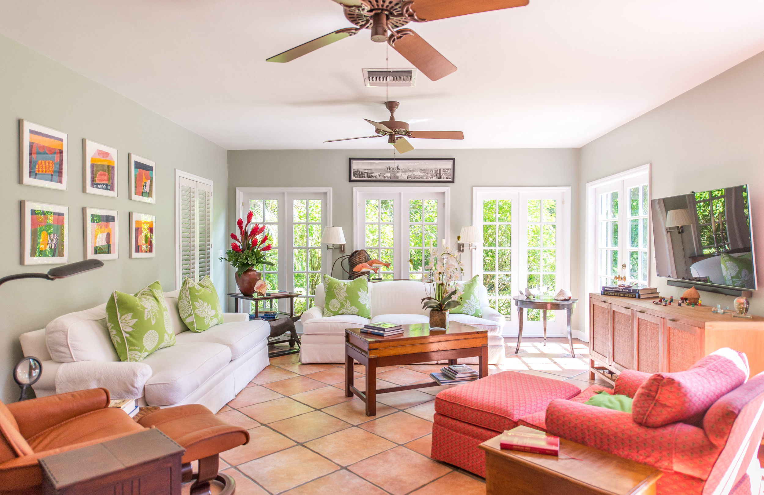 Beautiful and bright family room, lined with French doors, bringing the outside in.
