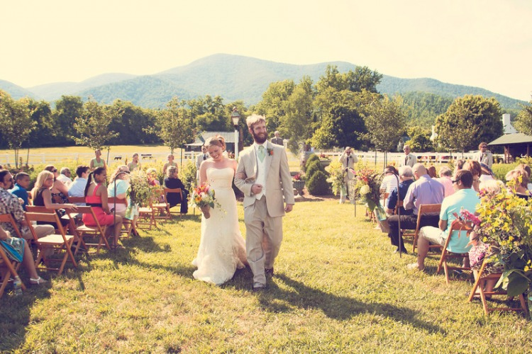 bride and groom outdoors in front of mountain