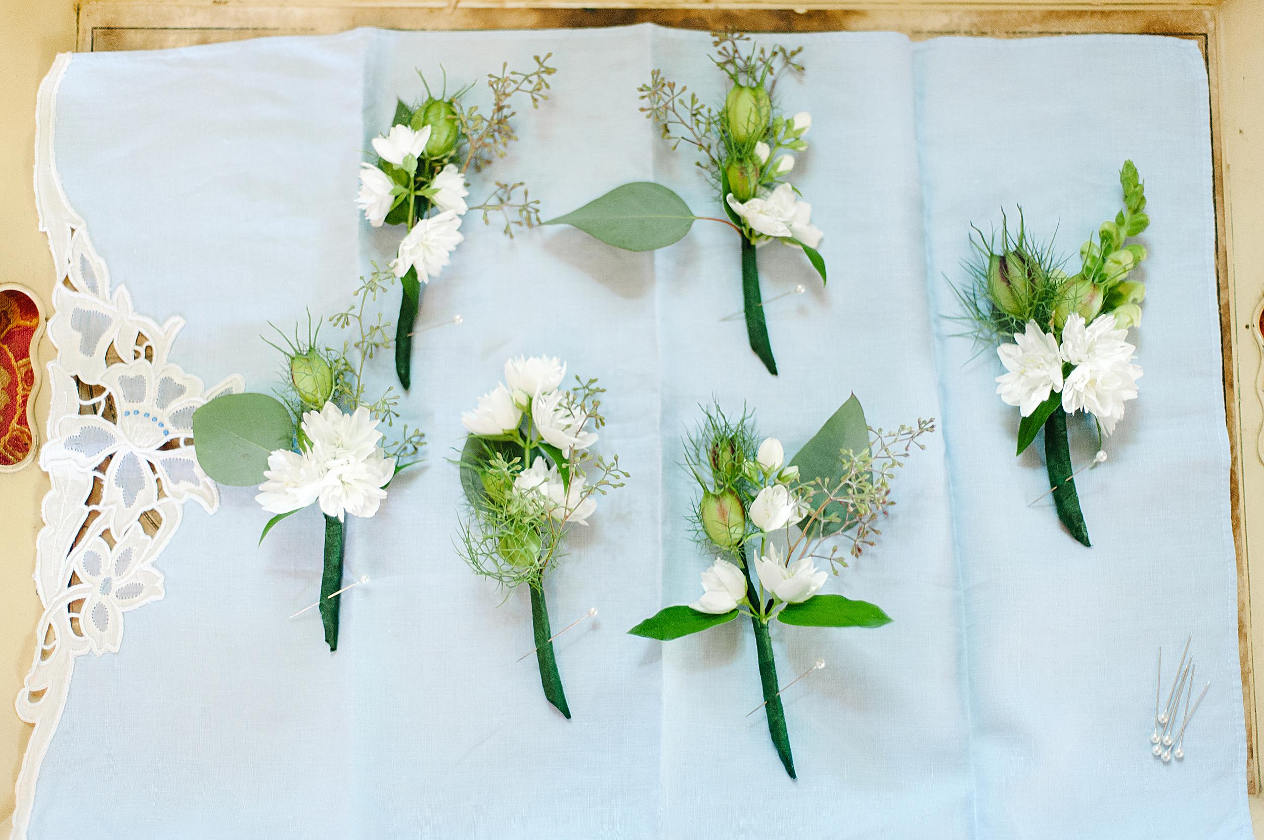 Boutonnieres featured Nigella, fragrant mock orange, and seeded eucalyptus.