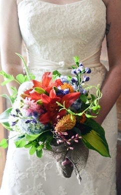 bride holding flower arrangement
